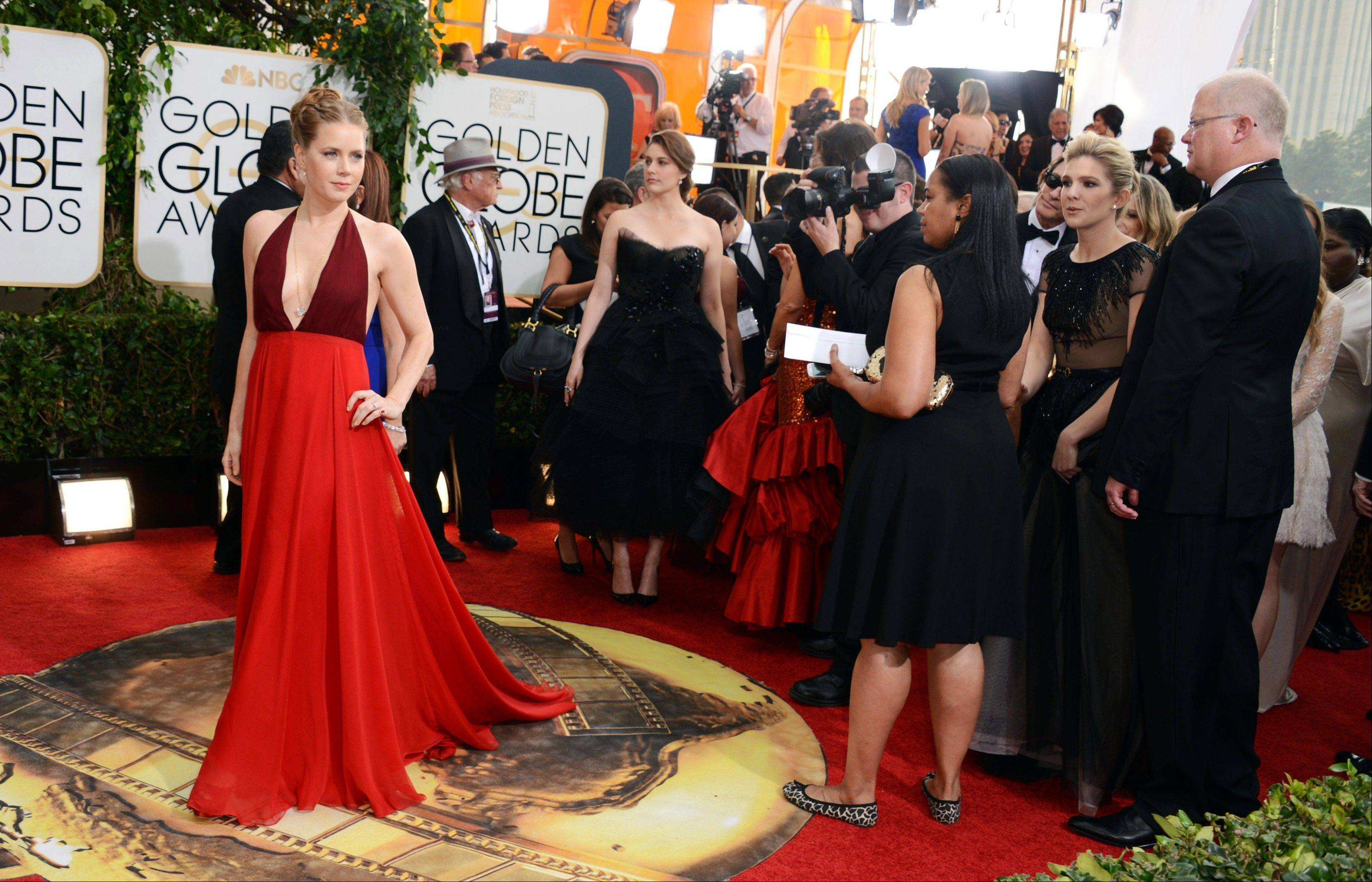 """American Hustle"" star Amy Adams arrives at the 71st annual Golden Globe Awards."