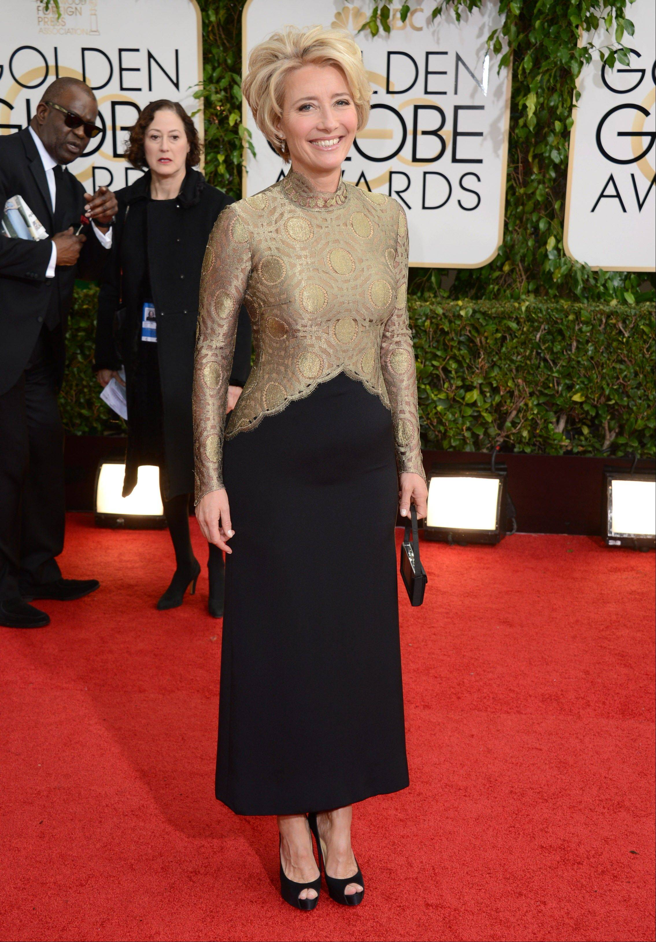 """Saving Mr. Banks"" star Emma Thompson arrives at the 71st annual Golden Globe Awards."
