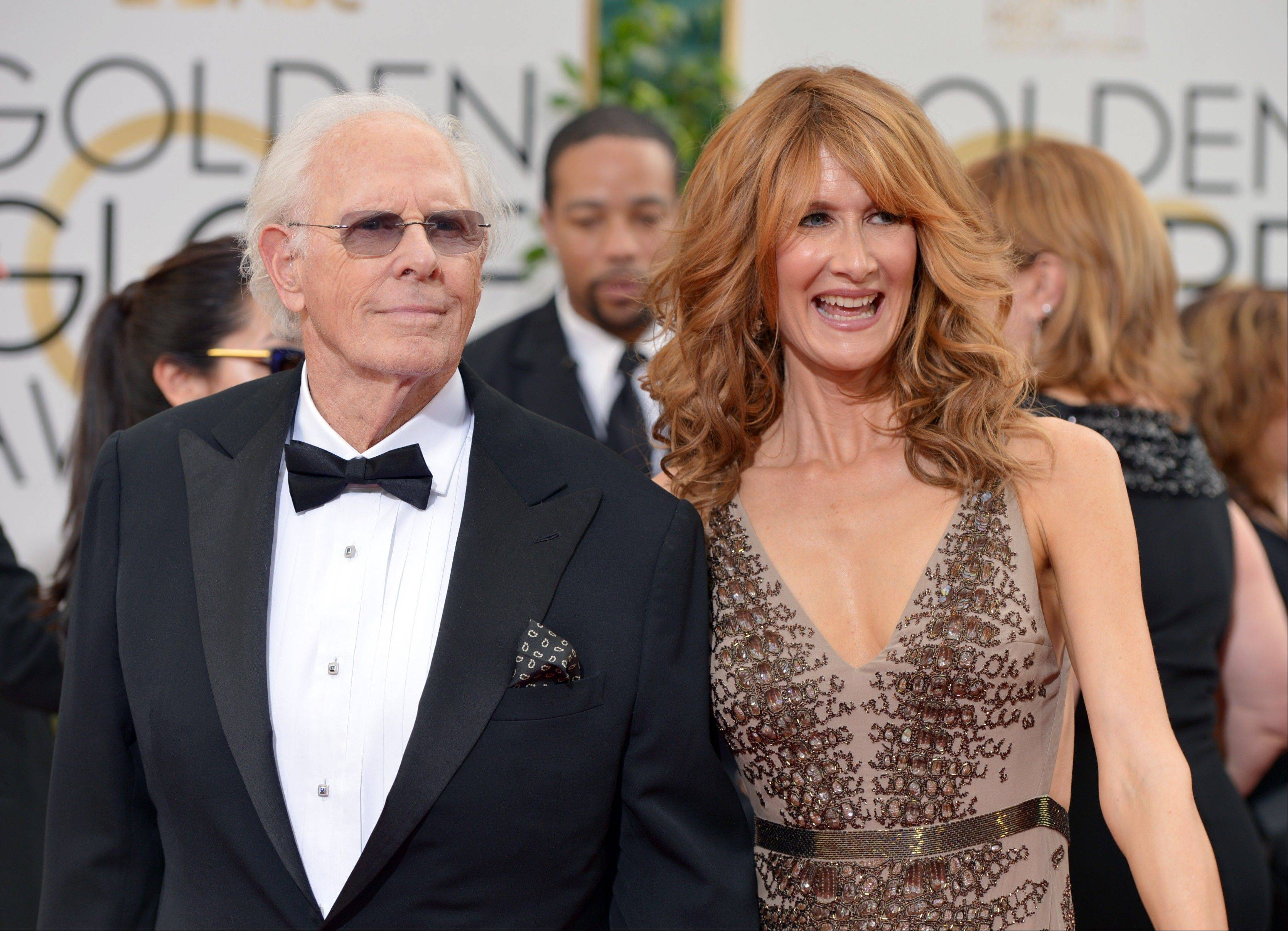 """Nebraska"" star Bruce Dern poses with his daughter, actress Laura Dern, as they make their way down the red carpet."
