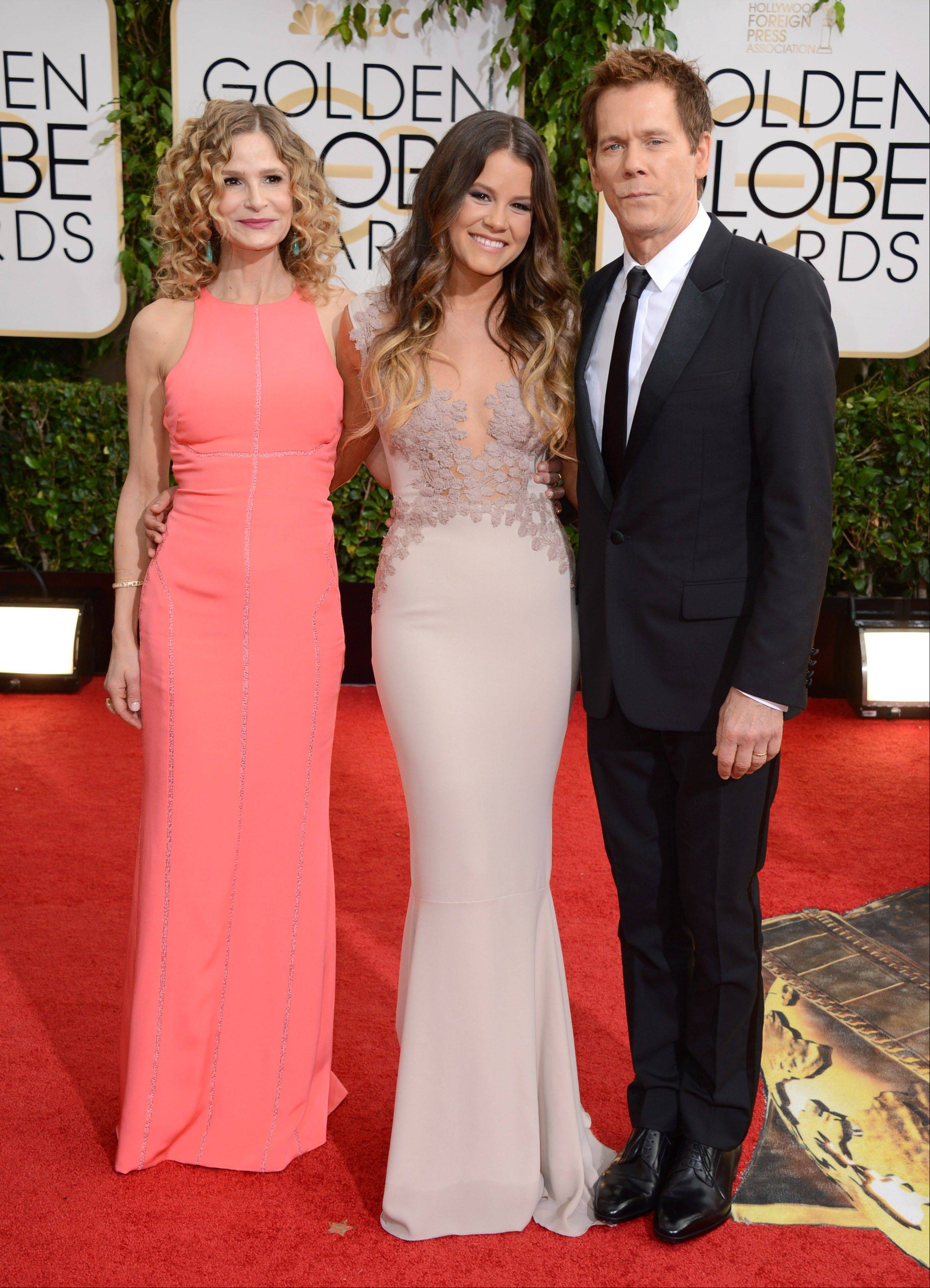 "Actress Kyra Sedgwick and her husband,""The Following"" star Kevin Bacon, walk the red carpet with their daughter Sosie Bacon, center, who is this year's Miss Golden Globe."