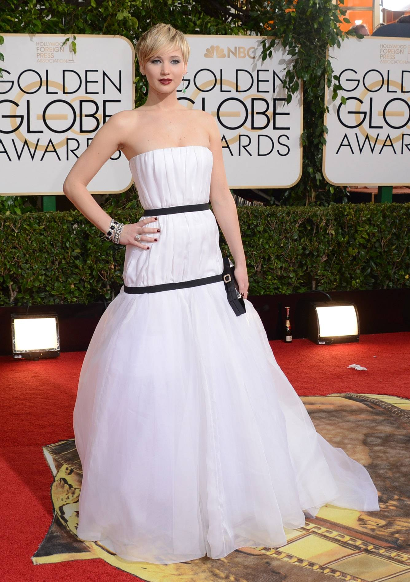 Jennifer Lawrence goes ethereal and edgy for her Golden Globes fashion.