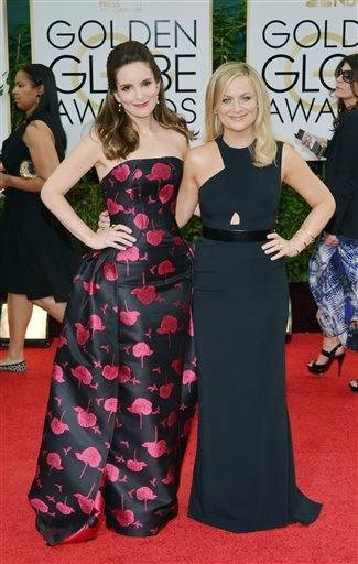 Golden Globe hosts Tina Fey and Amy Poehler take some time to pose along the red carpet before starting their ceremonial duties.