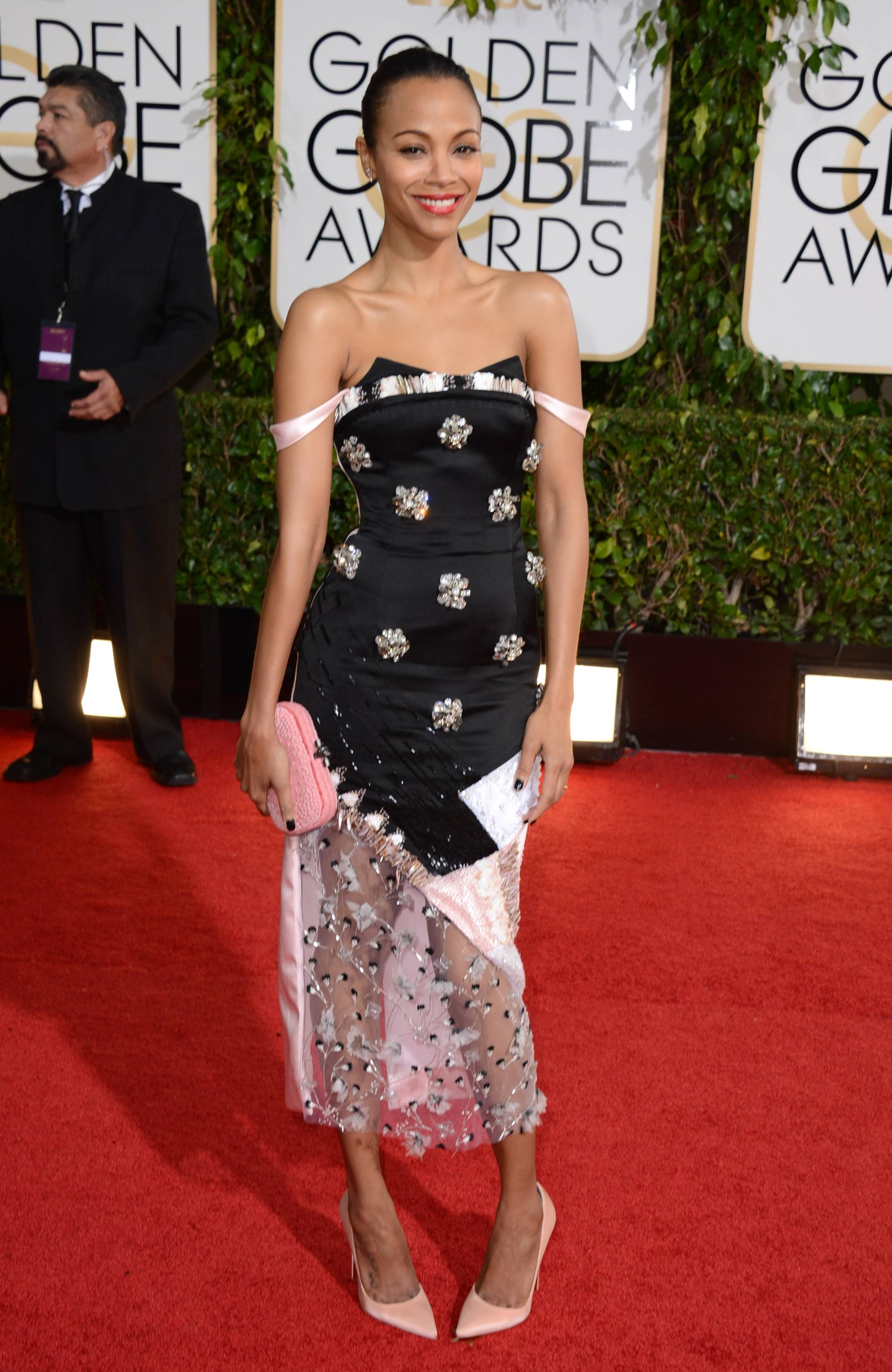 Zoey Saldana looks a little unsure in this somewhat awkward pose she struck on the red carpet.
