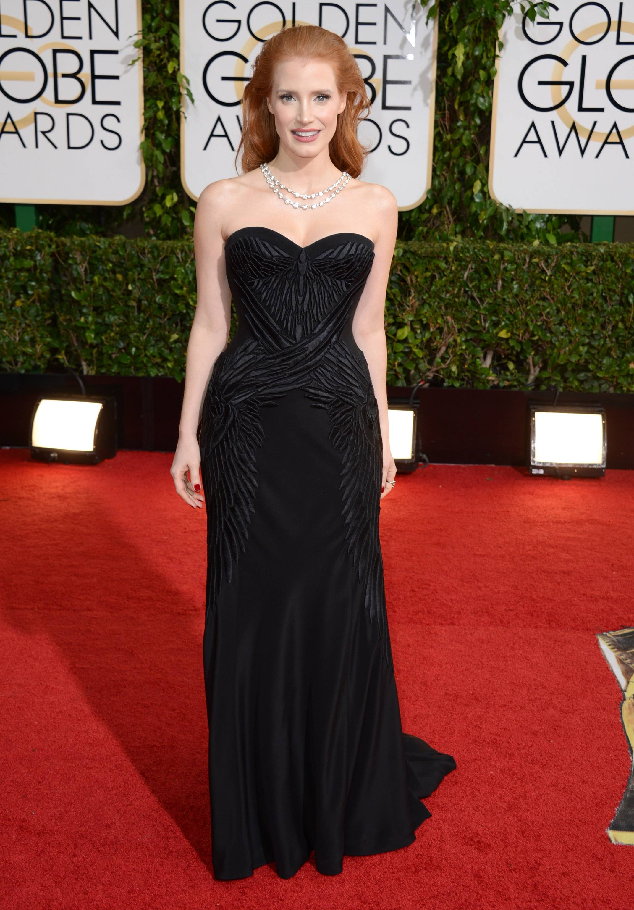 Jessica Chastain dons a classic black gown with a bit of a twist.