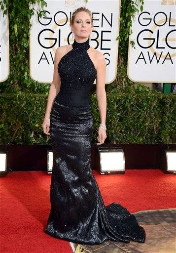Uma Thurman keeps the theme of black dresses going with this halter version.