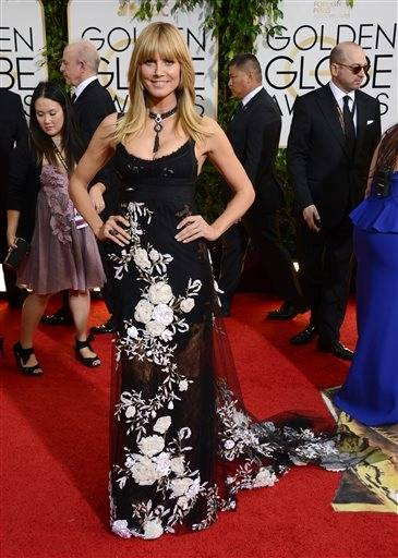 Very little could make Heidi Klum look bad, but it seems like this dress is actually trying.