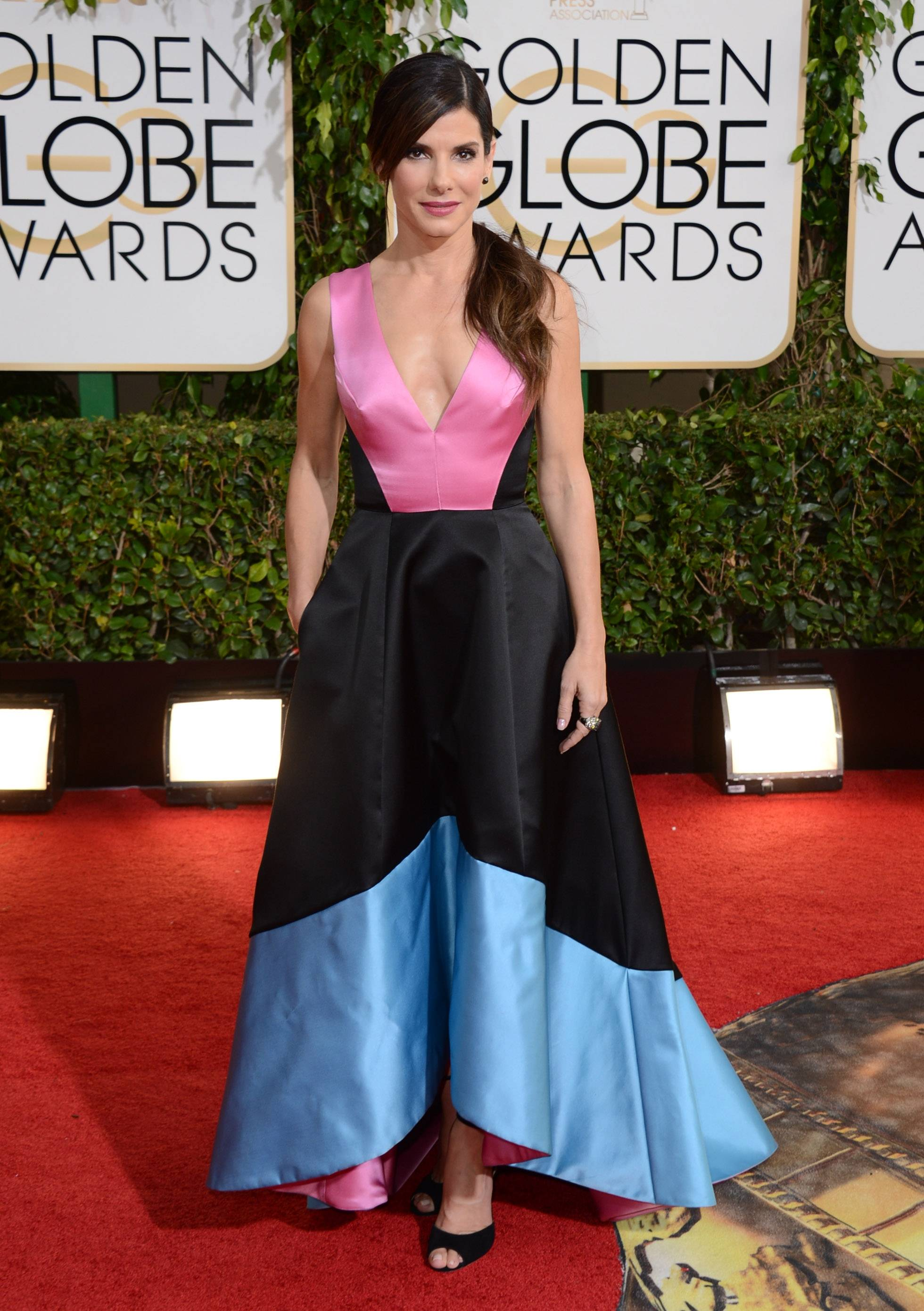 Sandra Bullock is usually a red carpet stunner, but this dress is distracting and not in the way she probably hoped it would be.
