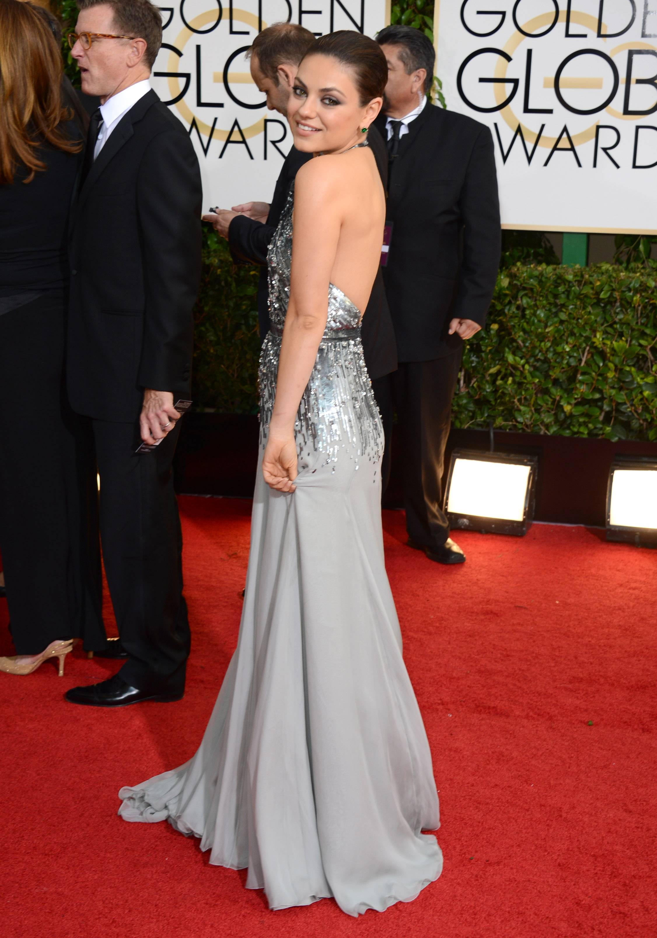 Mila Kunis bucks the black dress trend and goes for Tinsletown silver instead.