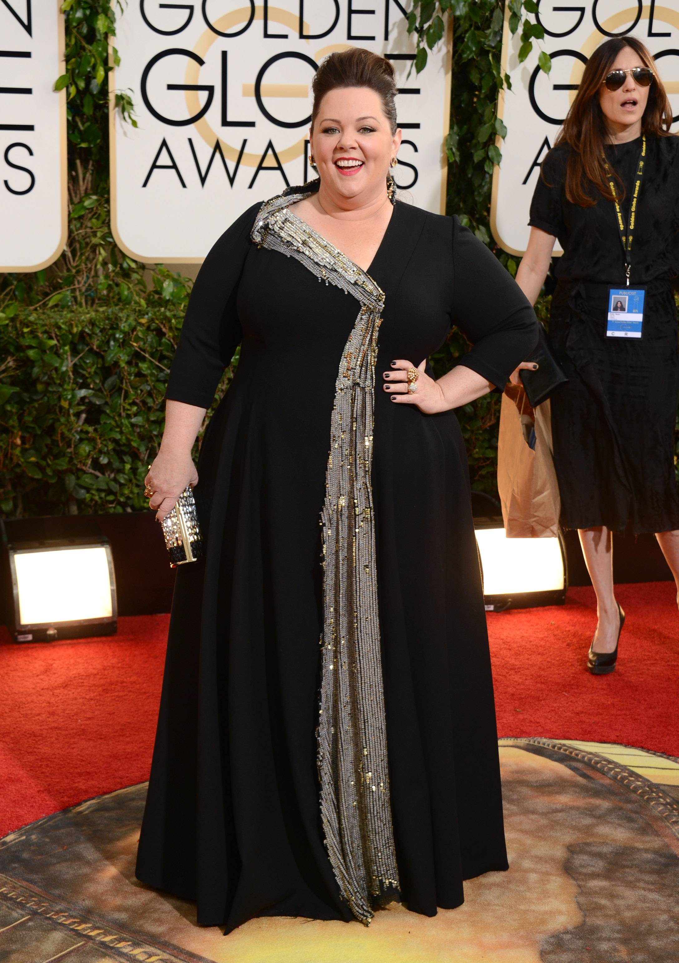 """The Heat"" star Melissa McCarthy keeps the black gown theme going on the red carpet Sunday night."