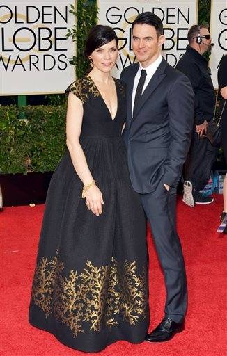 """The Good Wife"" star Julianna Marguiles and husband Keith Lieberthal pose for photographers on the red carpet."