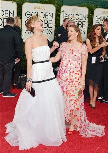Jennifer Lawrence and Drew Barrymore have a little fun together on the red carpet.