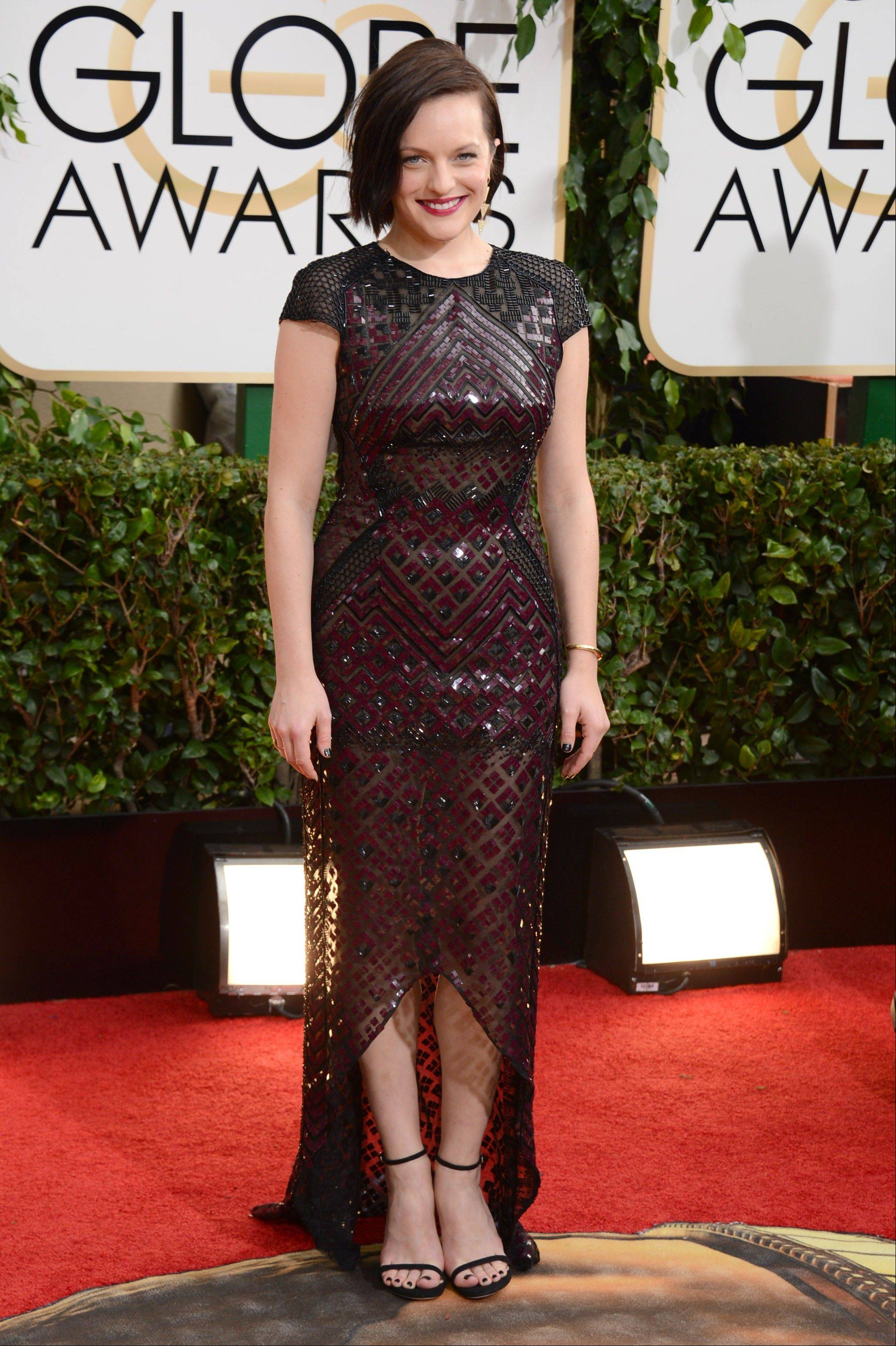 """Med Men"" and ""Top of the Lake"" Elisabeth Moss arrives at the 71st annual Golden Globe Awards."