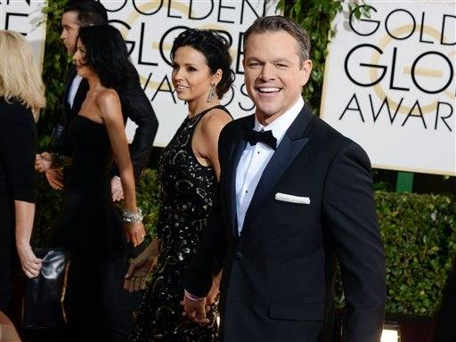 Matt Damon is all smiles as his wife, Luciana, walks down the red carpet with him.