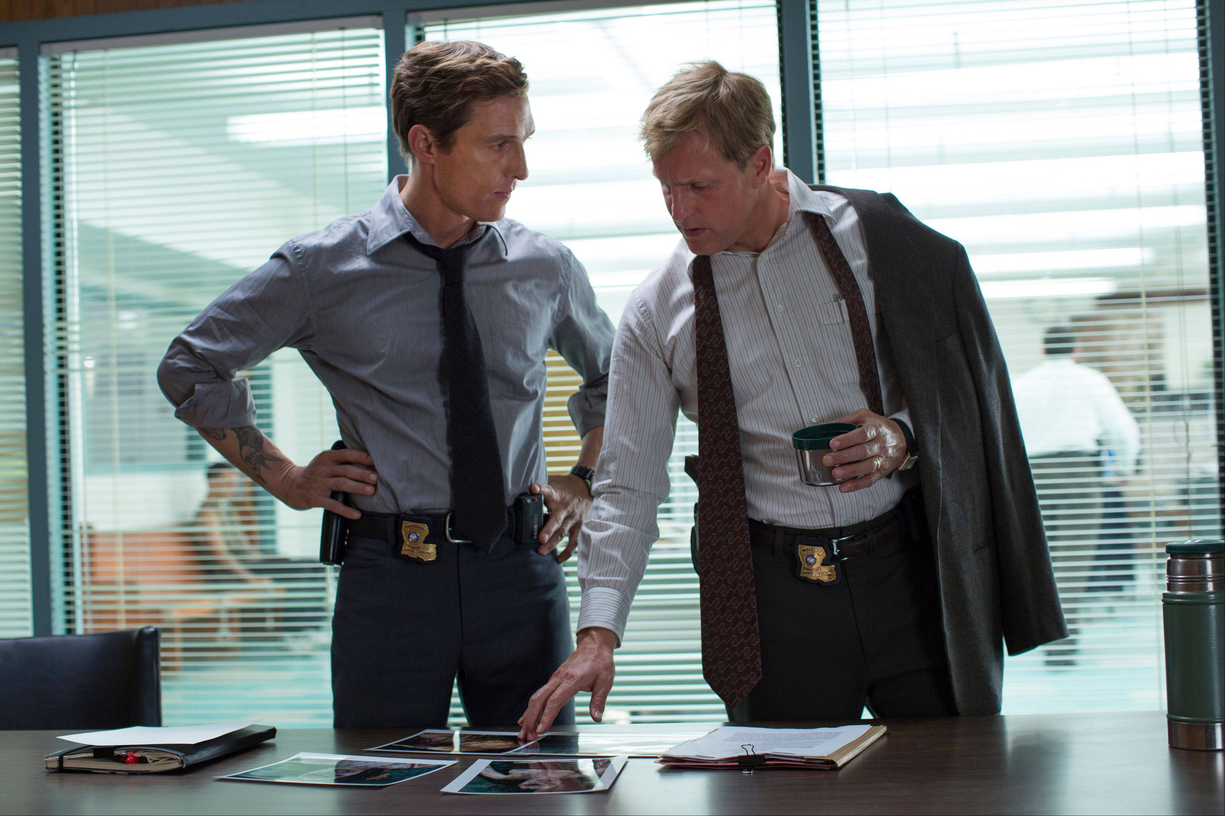 "Matthew McConaughey, left, and Woody Harrelson play former Louisiana State Police detectives interrogated in 2012 about a homicide case we see them working, in flashback, in 1995, in the HBO series ""True Detective,"" premiering at 8 p.m. Sunday."