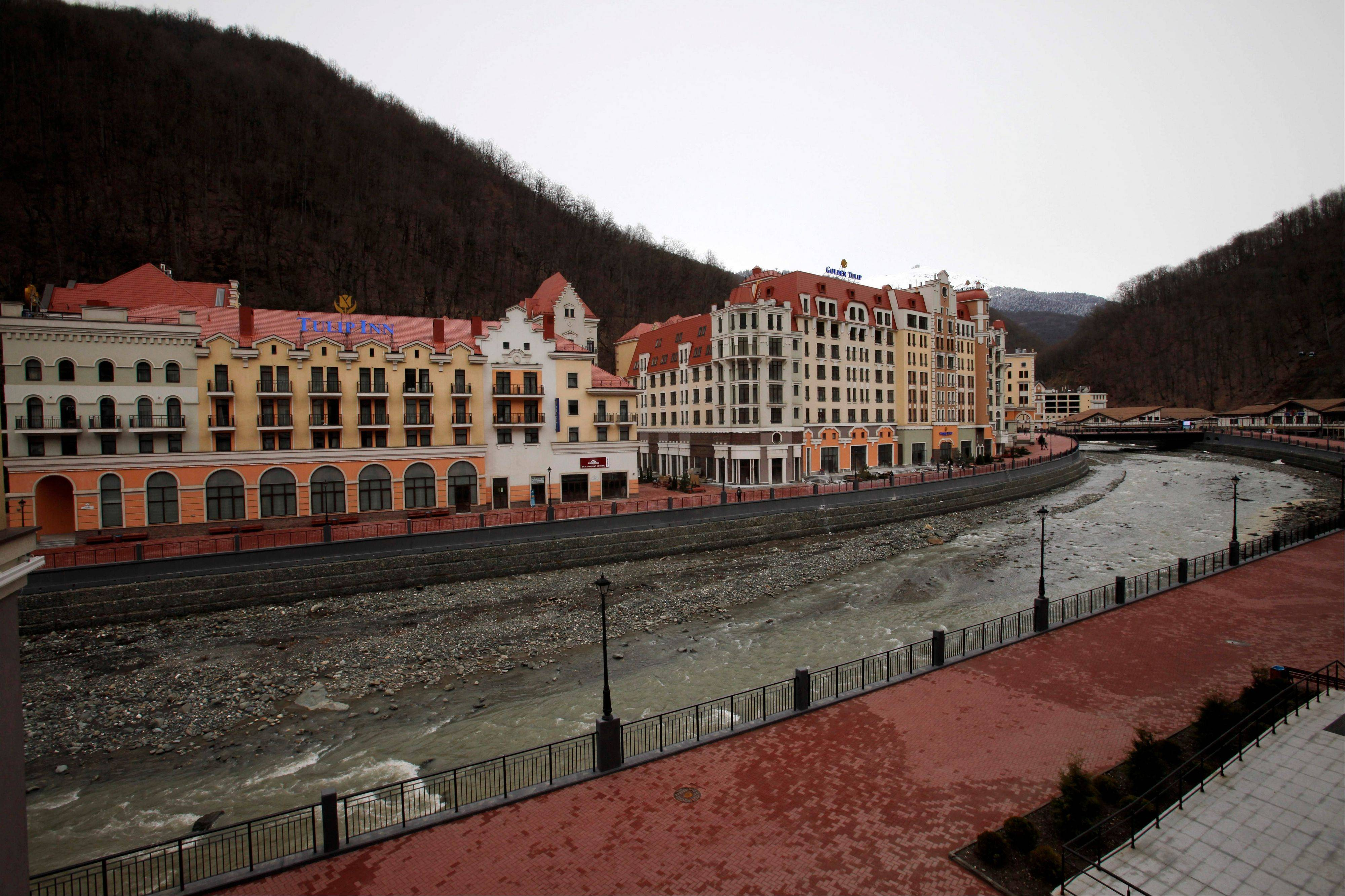 Newly built hotels to accommodate Olympic tourists sit along a river in Krasnaya Polyana near Sochi, Russia.