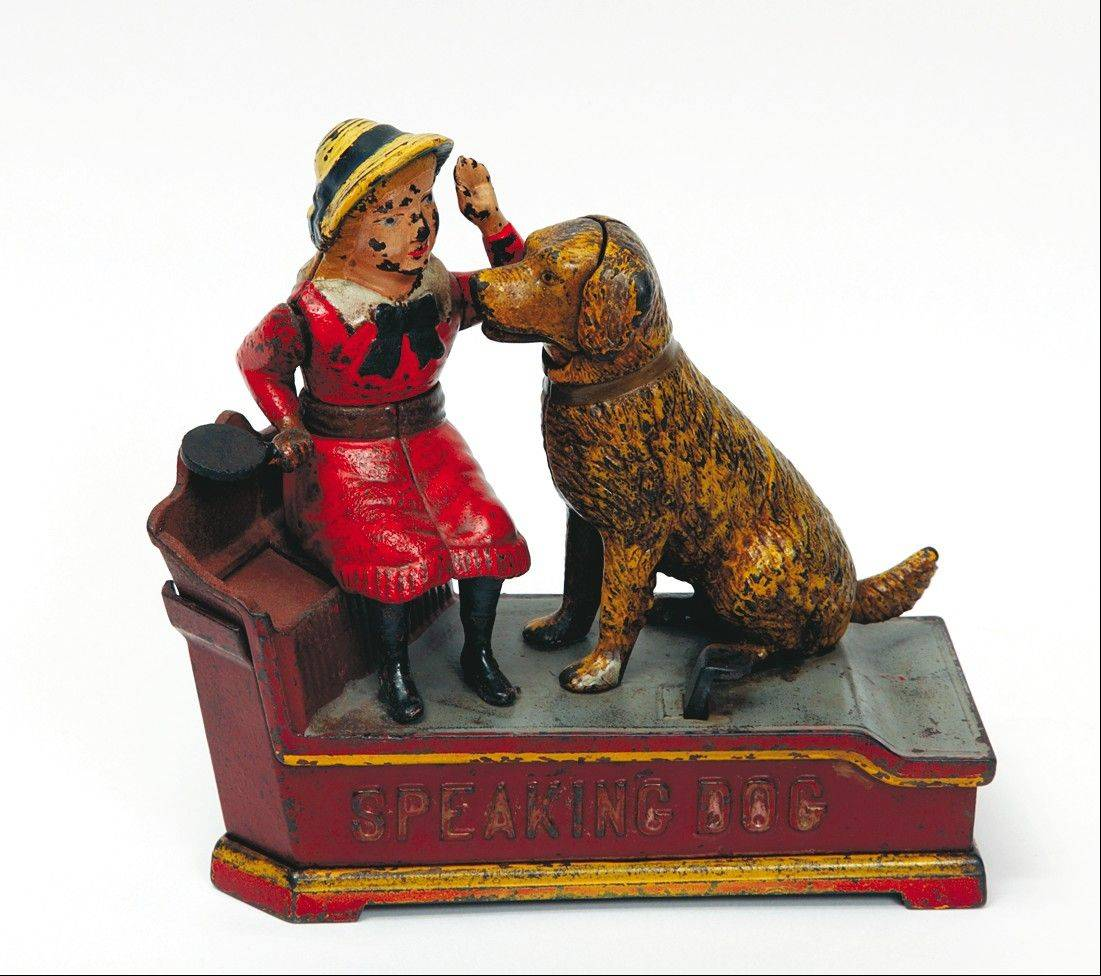 Speaking Dog, a cast-iron bank made in the late 1800s, has a substantive value. However, an identical piece with the girl in a blue dress can sell for more -- $1,500 if in original condition.