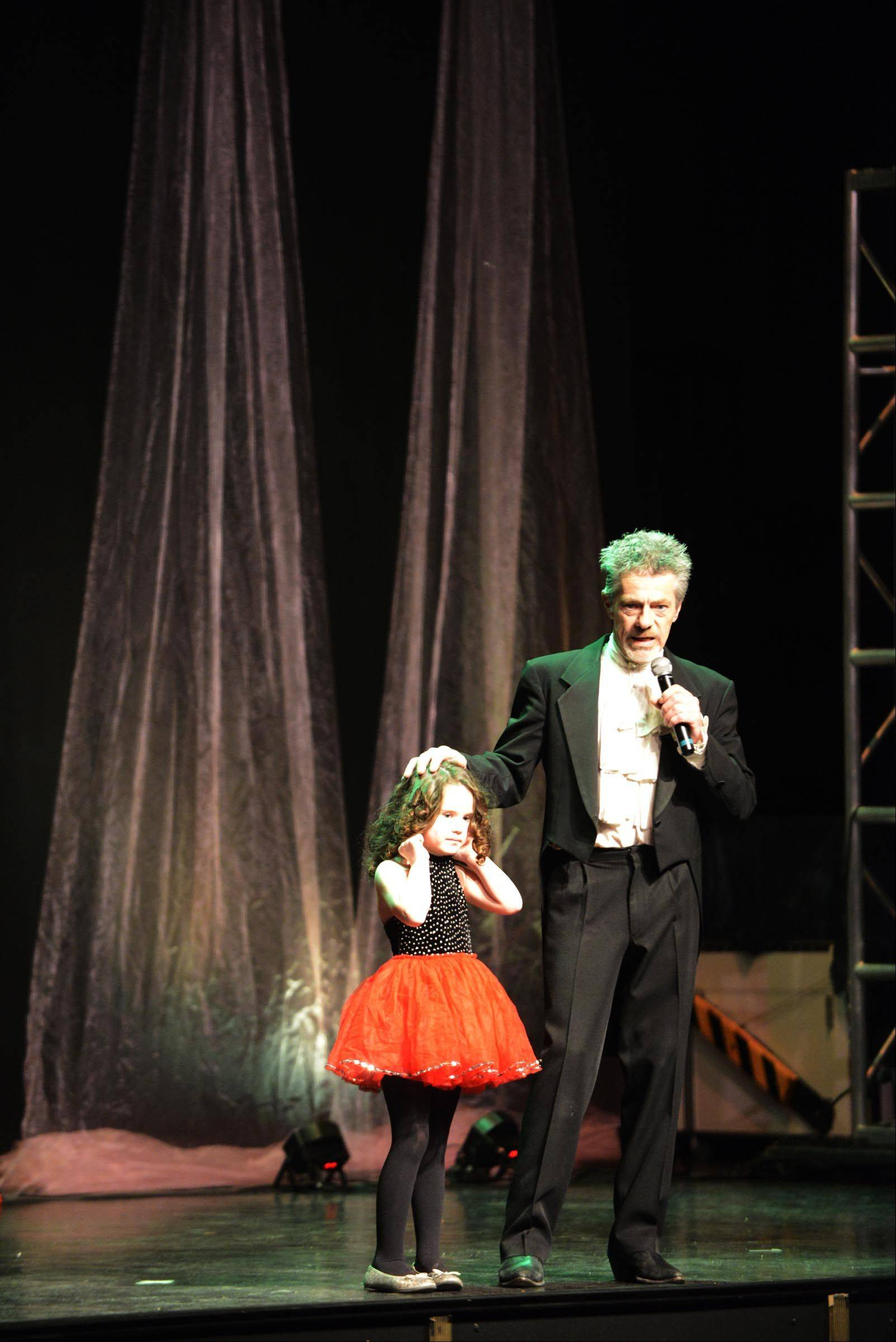 Magician Paul Lee introduces his niece Teagan Sunday onstage at the Arcada Theater in St. Charles. He was hosting the third annual Believe in Magic show, sponsored by the National Association for Down Syndrome. Teagan has Down syndrome.