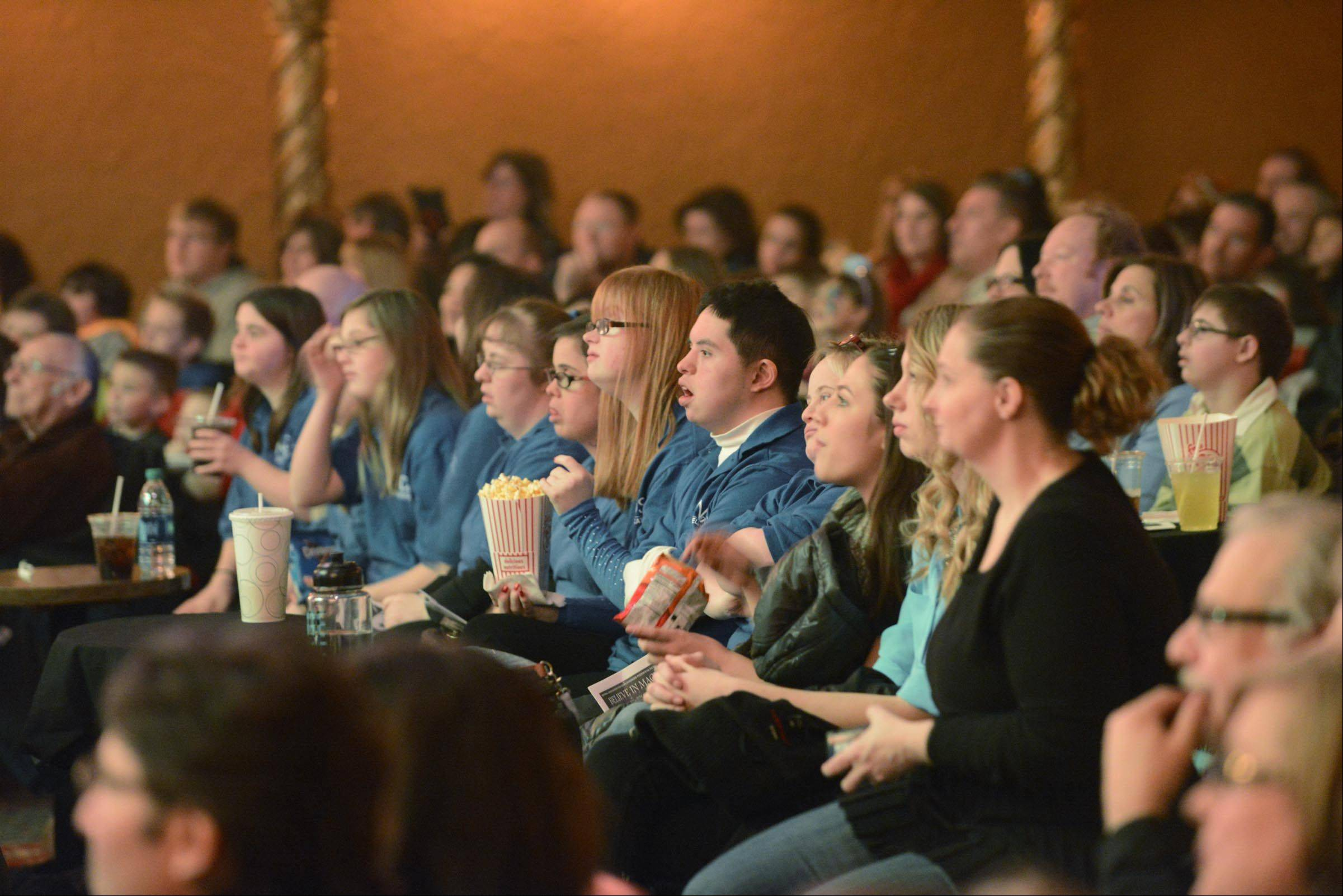 The audience watches as magician Paul Lee performs Sunday at the Arcada Theater in St. Charles. He was hosting the third annual Believe in Magic show, sponsored by the National Association for Down Syndrome.