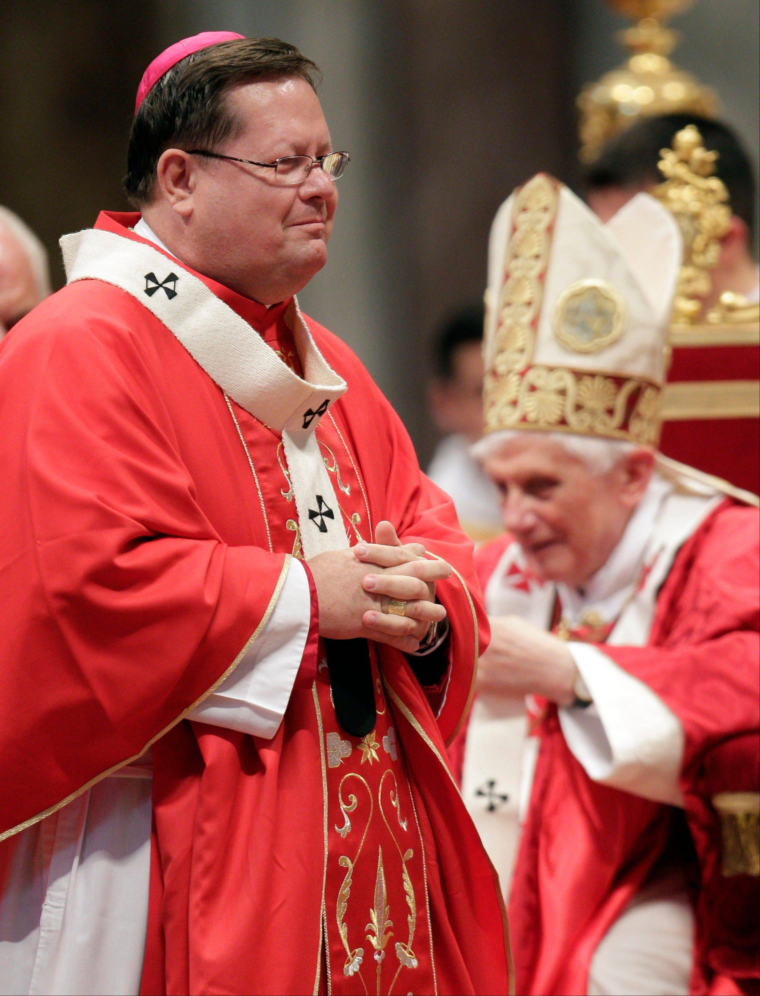 Archbishop of Quebec Gerald Cyprien Lacroix, shown walking past Pope Benedict XVI after receiving the pallium, is among the 19 new cardinals that Pope Francis announced Sunday.