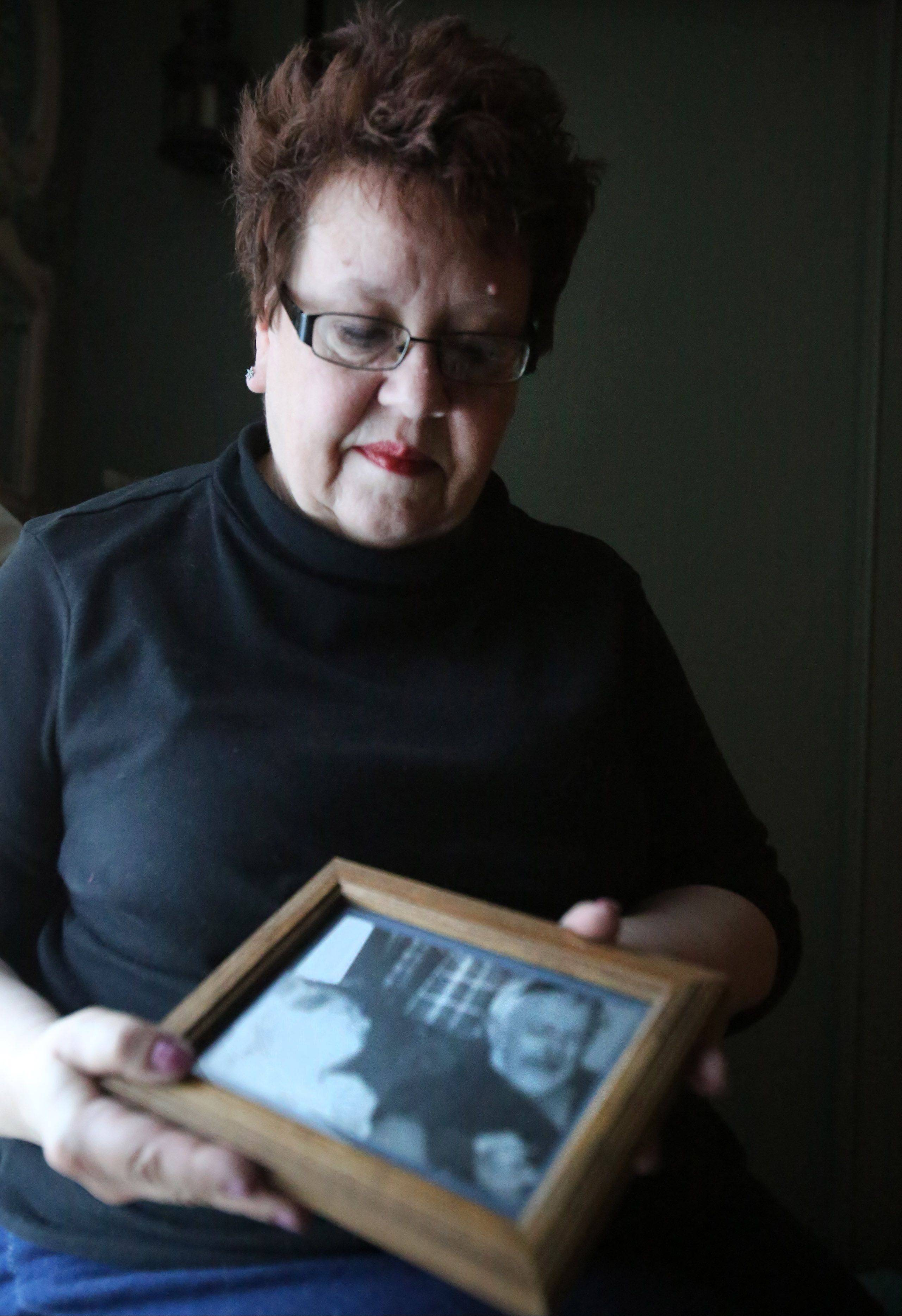 Mary Swieca holds a photograph of her husband, Joseph, who was killed when he was struck by a car in December near his home in Elk Grove Township.