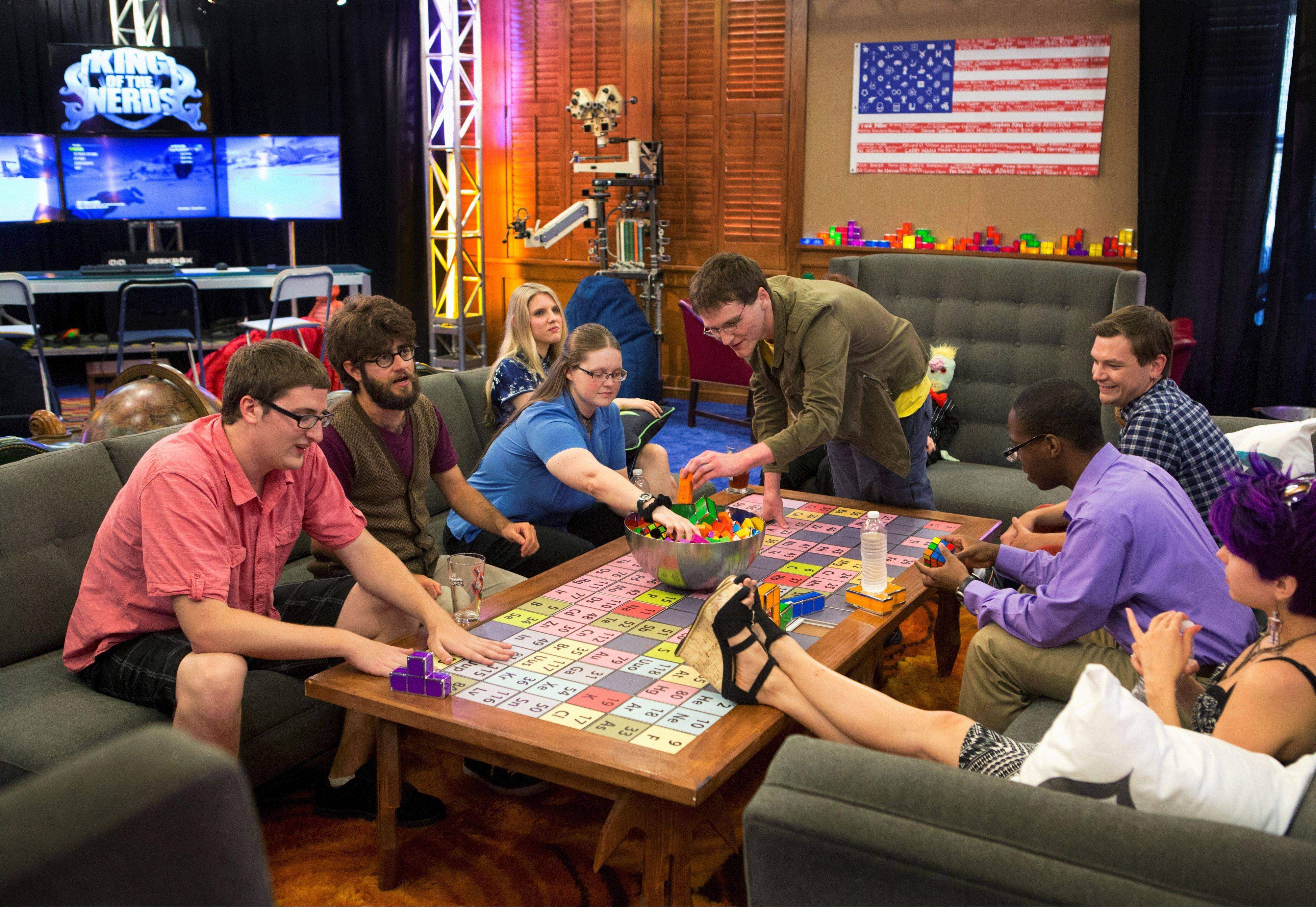 "Living in ""Nerdvana,"" Grayslake native Josh Wittenkeller, far left, shares a moment with fellow nerds Brian, Kayla, Kelsey, Zack, Xander, Chris and Katie."
