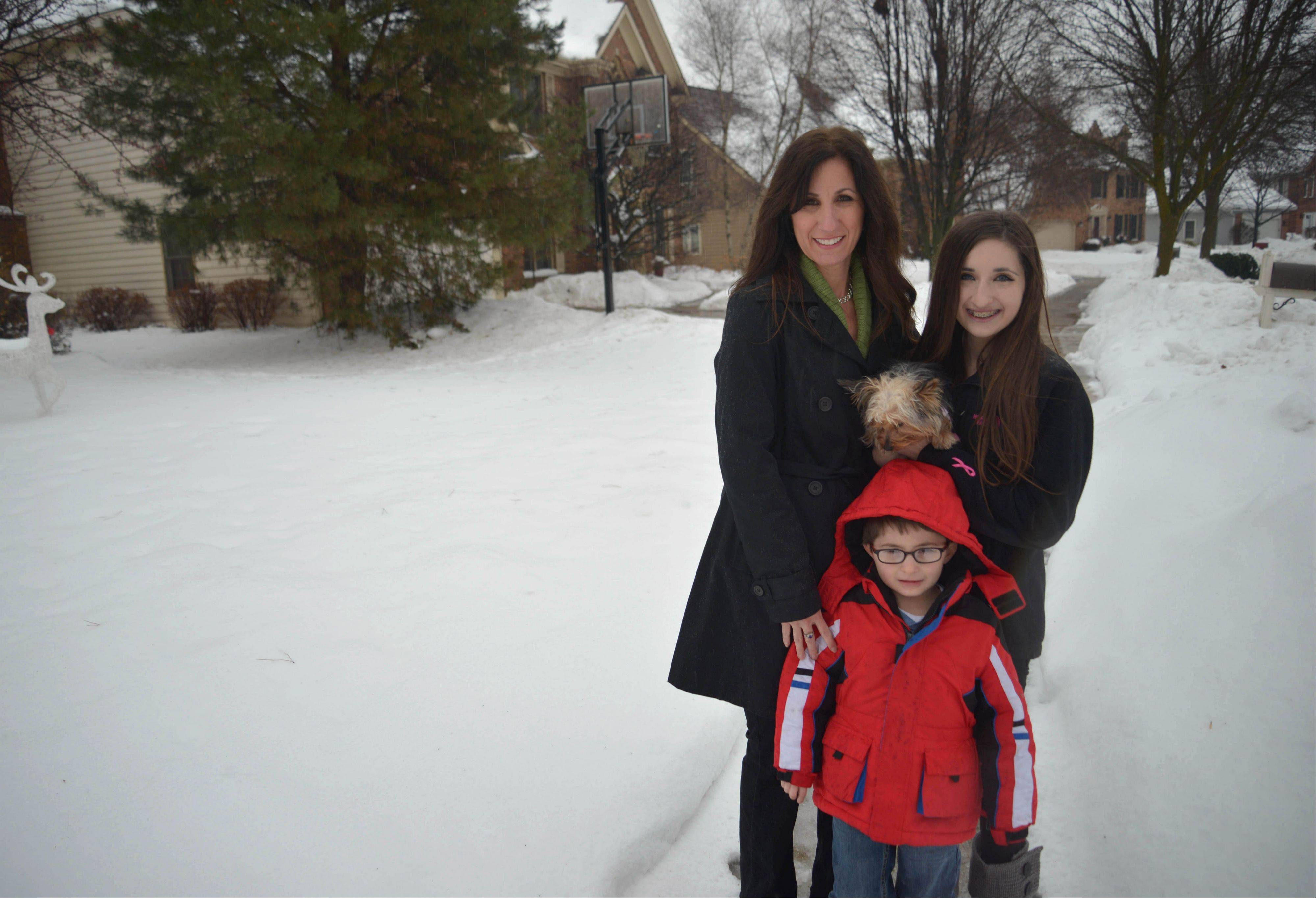 The Cincinello family remains shaken by the death of their 12-year-old white Maltese, Daisy, who was grabbed by a coyote in the front yard of their Wheaton home. The family -- mom Carol, Ryan, 5, and Sara, 14 -- hold their new dog, Dixie.