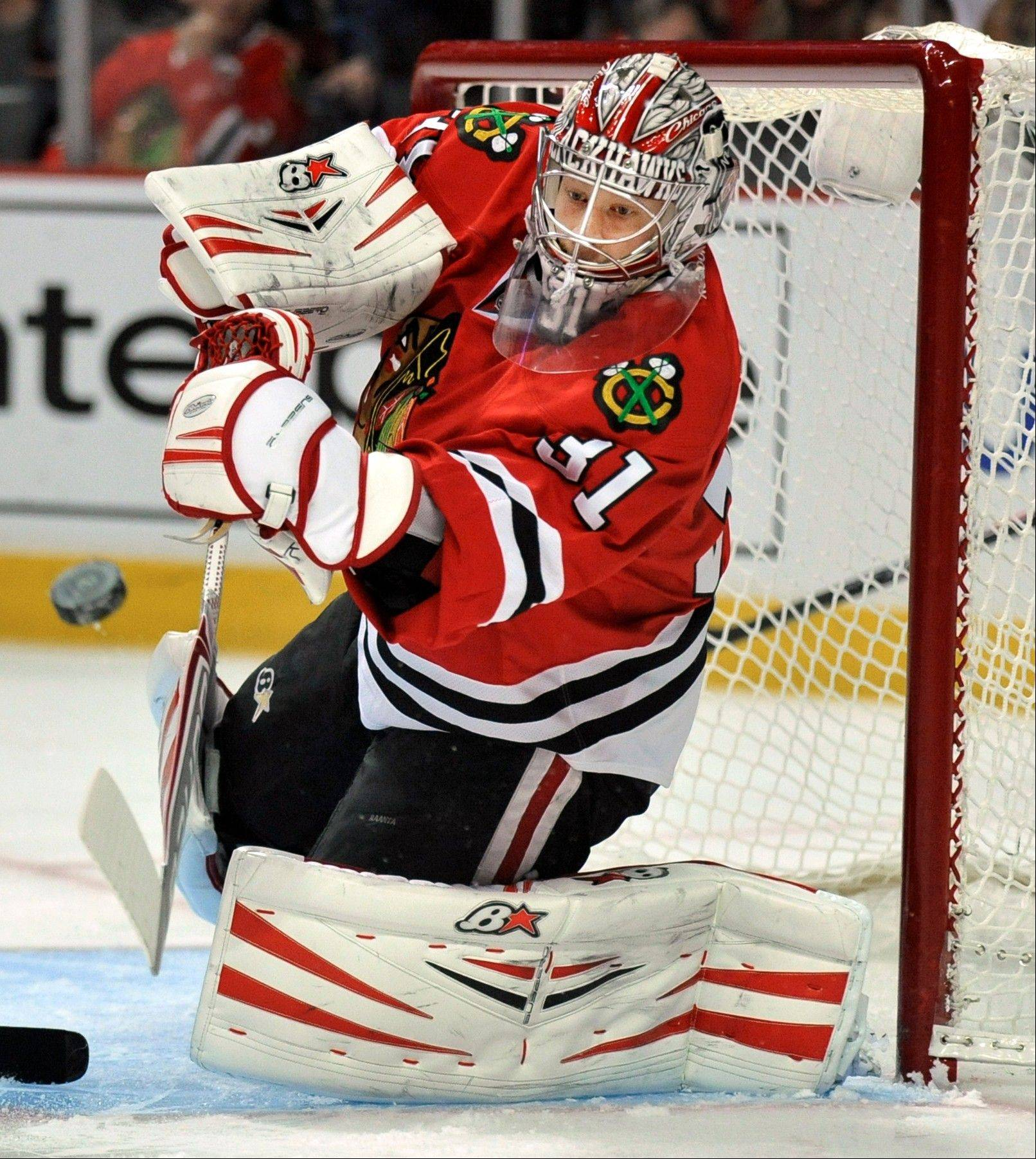 Chicago Blackhawks goalie Antti Raanta makes a save during the first period of an NHL hockey game against the Edmonton Oilers in Chicago, Sunday, Jan., 12, 2014.