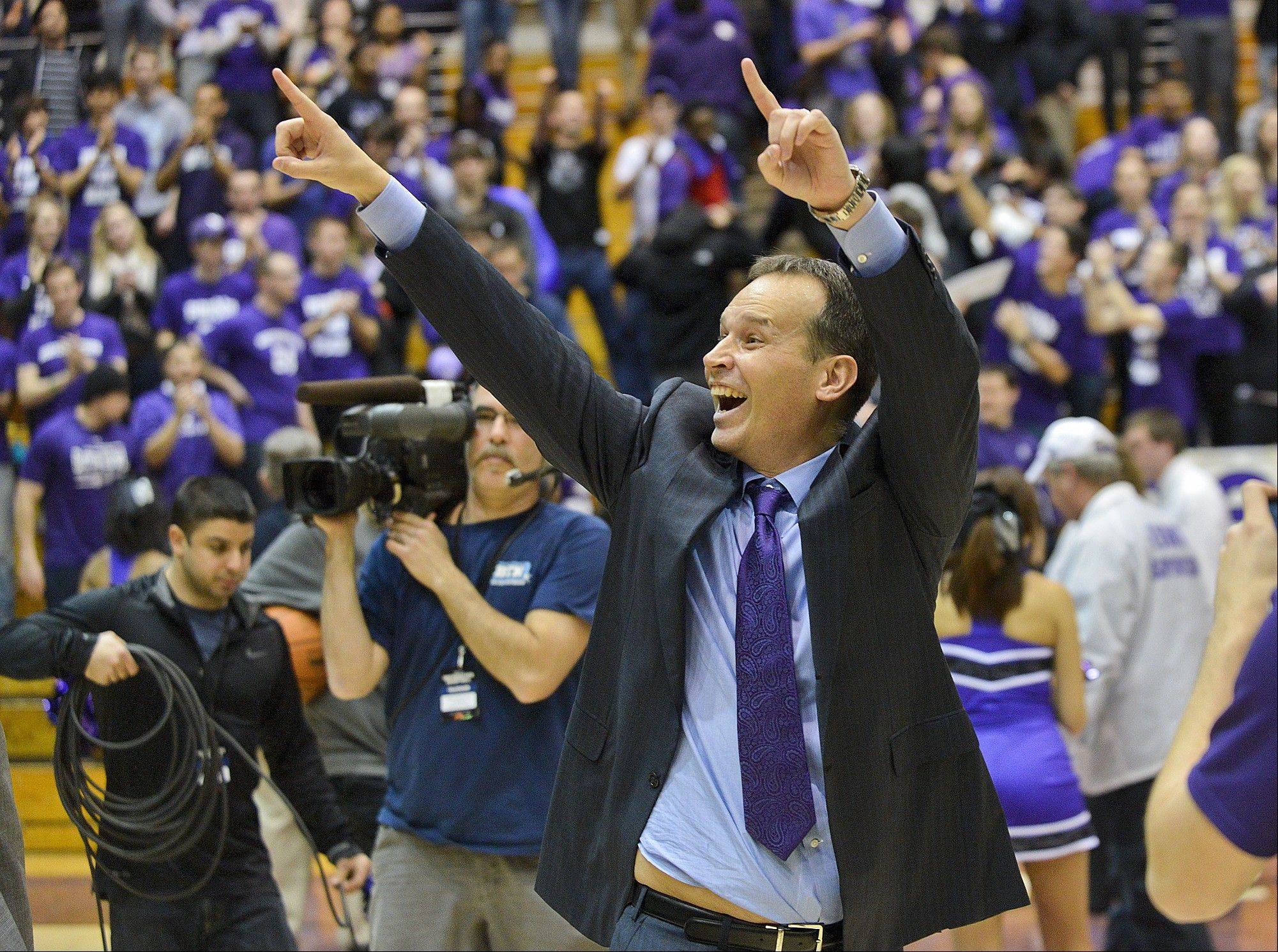 Northwestern head coach Chris Collins yells after his team beat Illinois 49-43 during an NCAA college basketball game in Evanston, Ill., on Sunday, Jan. 12, 2014.