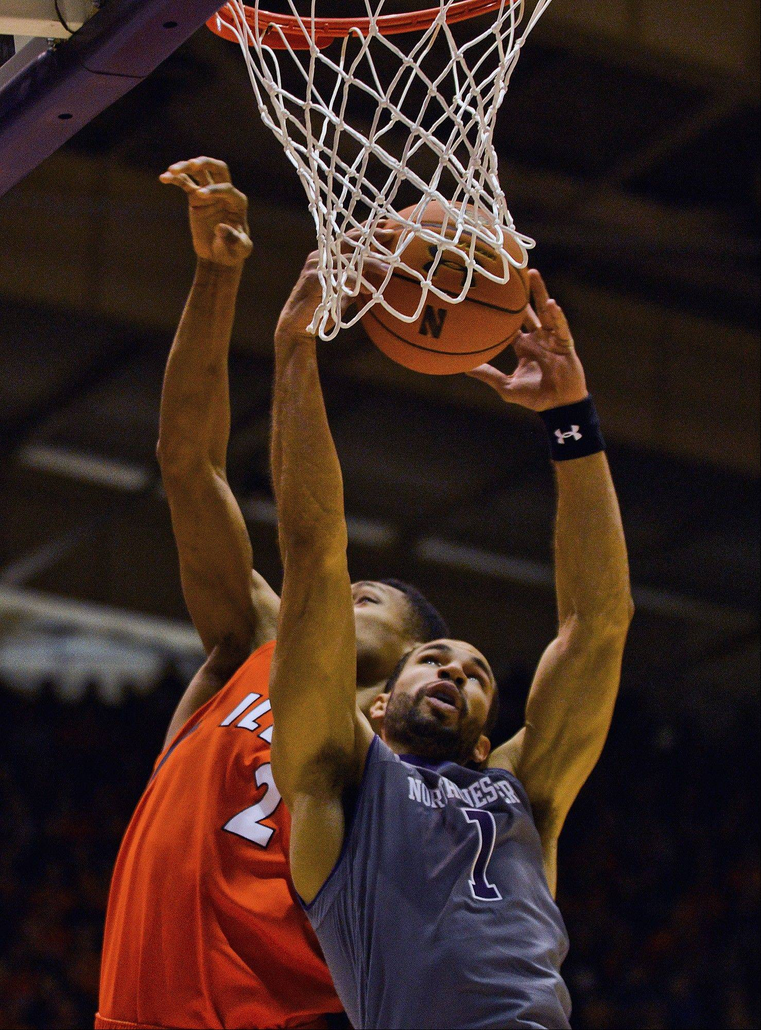 Northwestern's Drew Crawford (1) grabs a rebound from Illinois' Joseph Bertrand (2) during the first half of an NCAA college basketball game in Evanston, Ill., on Sunday, Jan. 12, 2014.