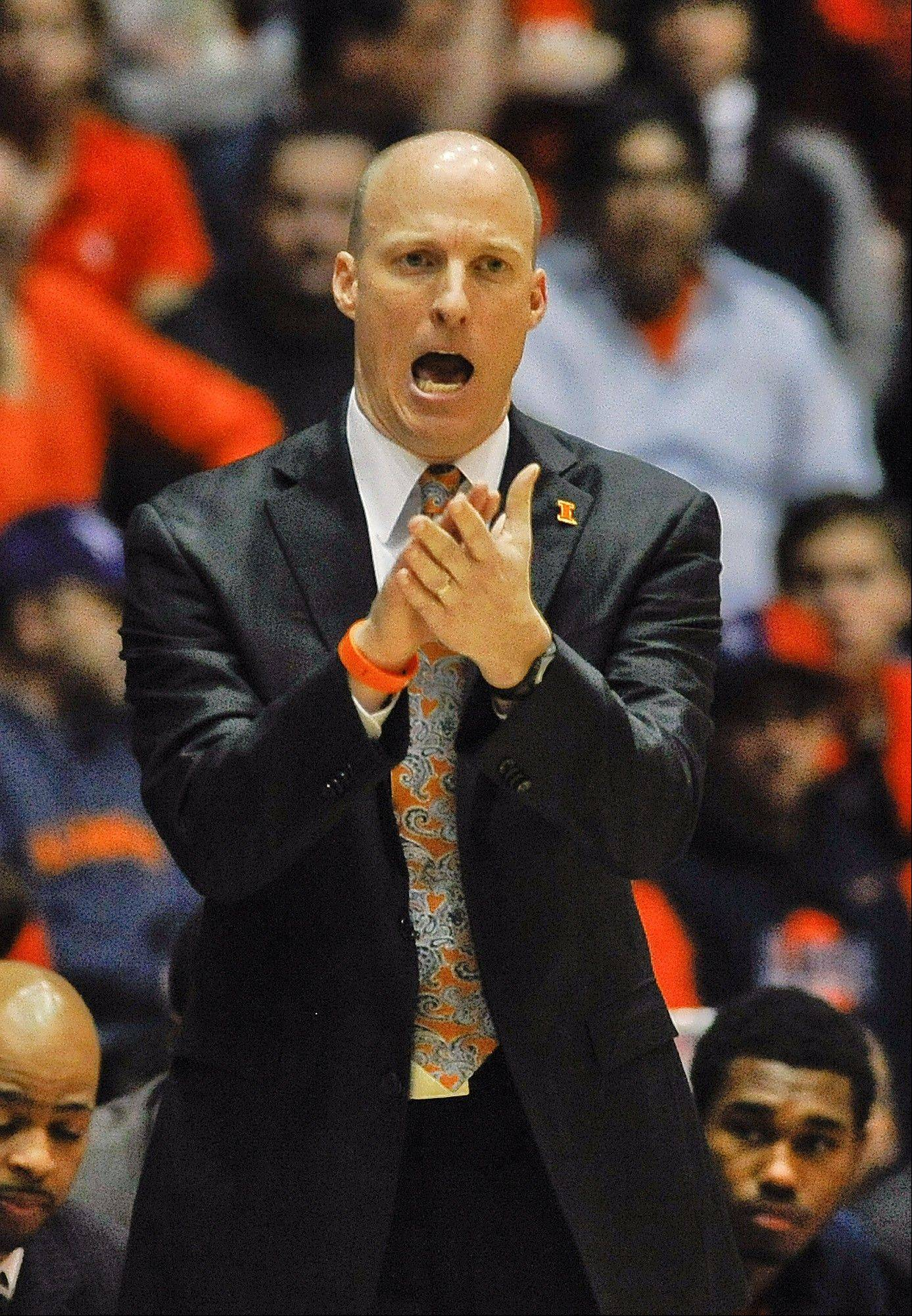 Illinois head coach John Groce yells while on the sideline during the first half of an NCAA college basketball game in Evanston, Ill., on Sunday, Jan. 12, 2014.