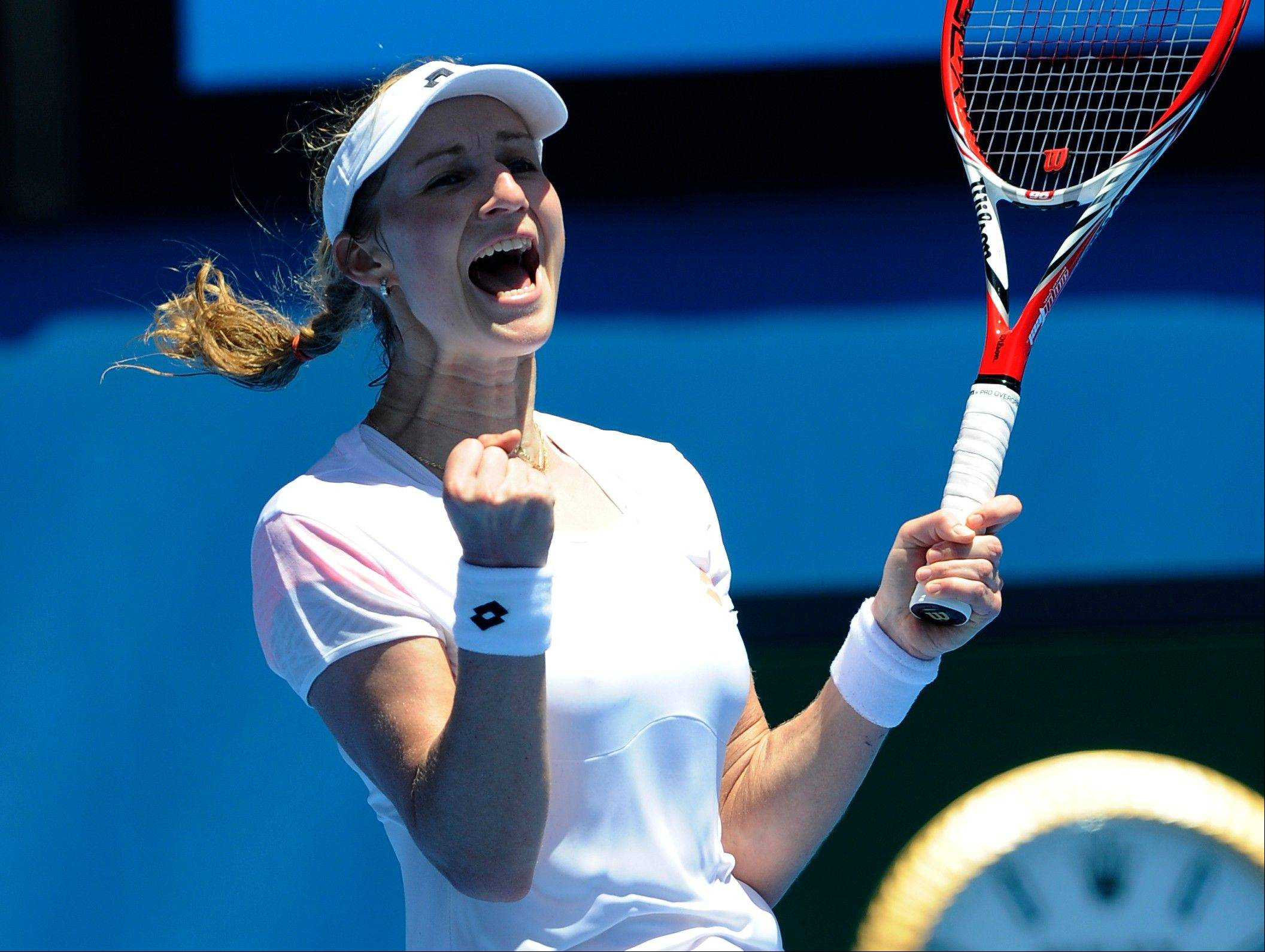 Ekaterina Makarova of Russia celebrates her win over Venus Williams of the U.S. during their first round match at the Australian Open tennis championship in Melbourne, Australia, Monday, Jan. 13, 2014.