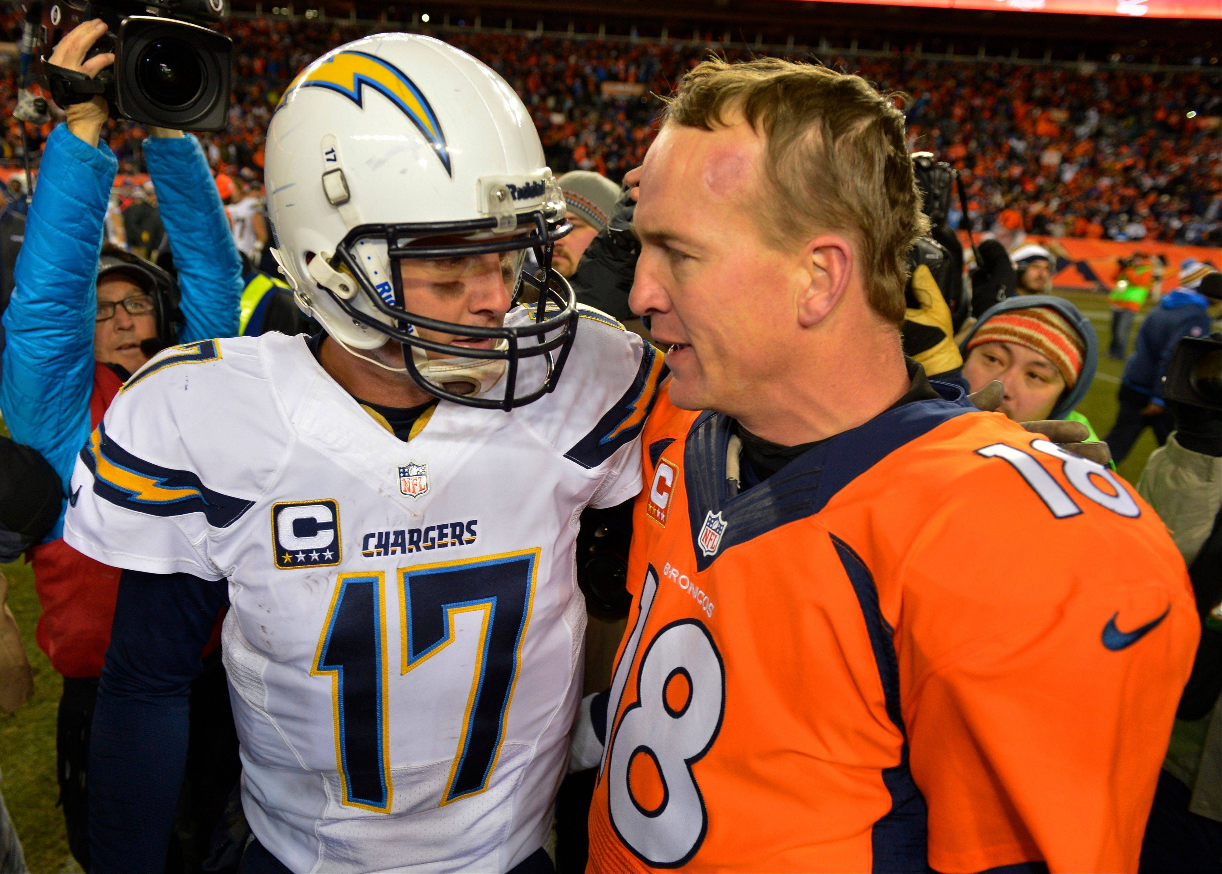 San Diego Chargers quarterback Philip Rivers, left, and Denver Broncos quarterback Peyton Manning greet each other at midfield after the Broncos beat the Chargers 24-17 in an NFL AFC division playoff football game, Sunday, Jan. 12, 2014, in Denver.