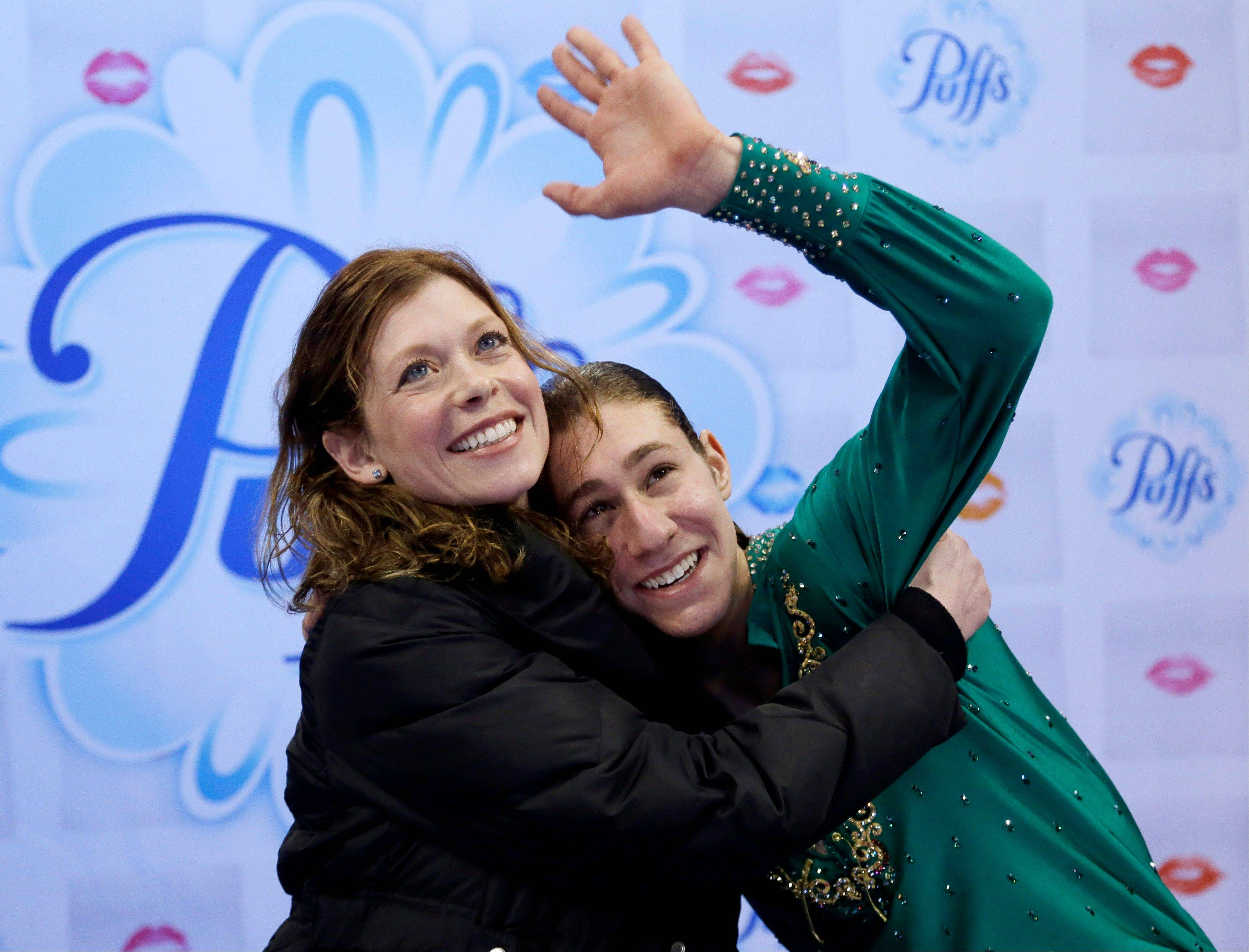 Highland Park's Jason Brown, right, celebrates with his coach, Kori Ade, as he learns his scores after competing in the men's free skate Sunday at the U.S. Figure Skating Championships in Boston.