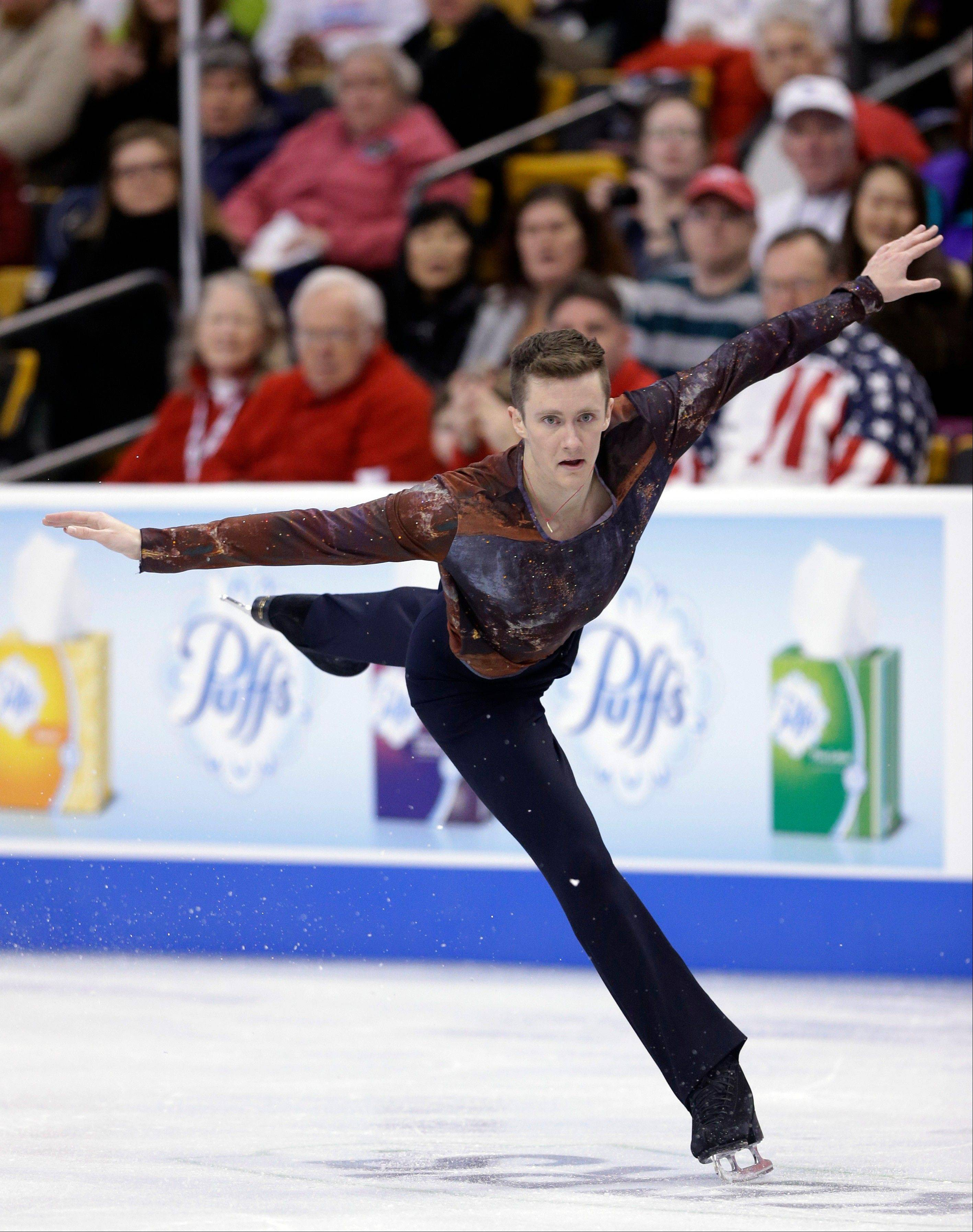 Jeremy Abbott competes during the men's free skate Sunday en route to winning his fourth national title.