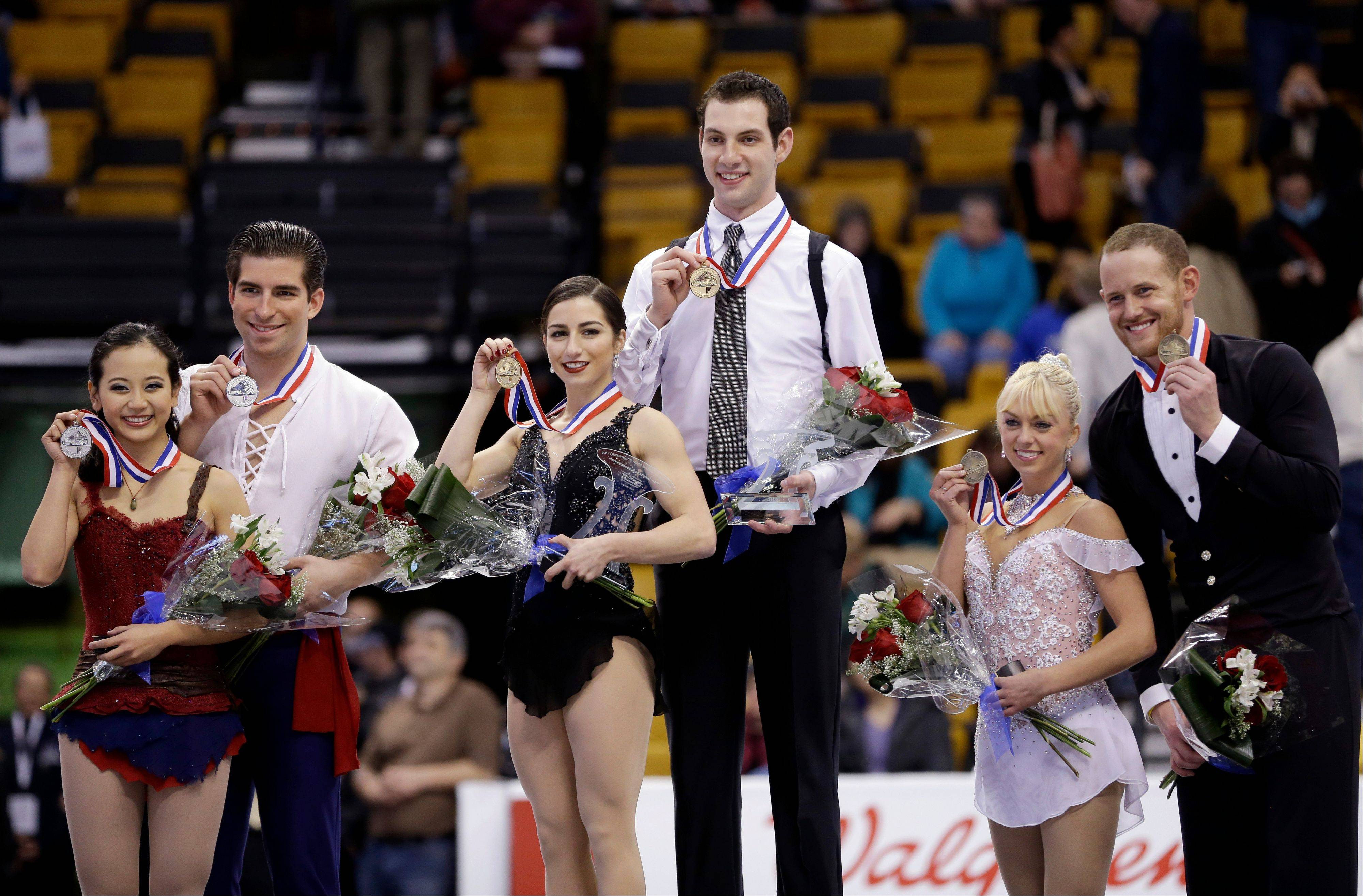 Marissa Castelli and Simon Shnapir, middle and first place winner in the pairs competition, pose with second-place winner Felicia Zhang and Nathan Bartholomay, left, and third-place winner Caydee Denney and John Coughlin during an awards ceremony at the U.S. Figure Skating Championships Saturday.