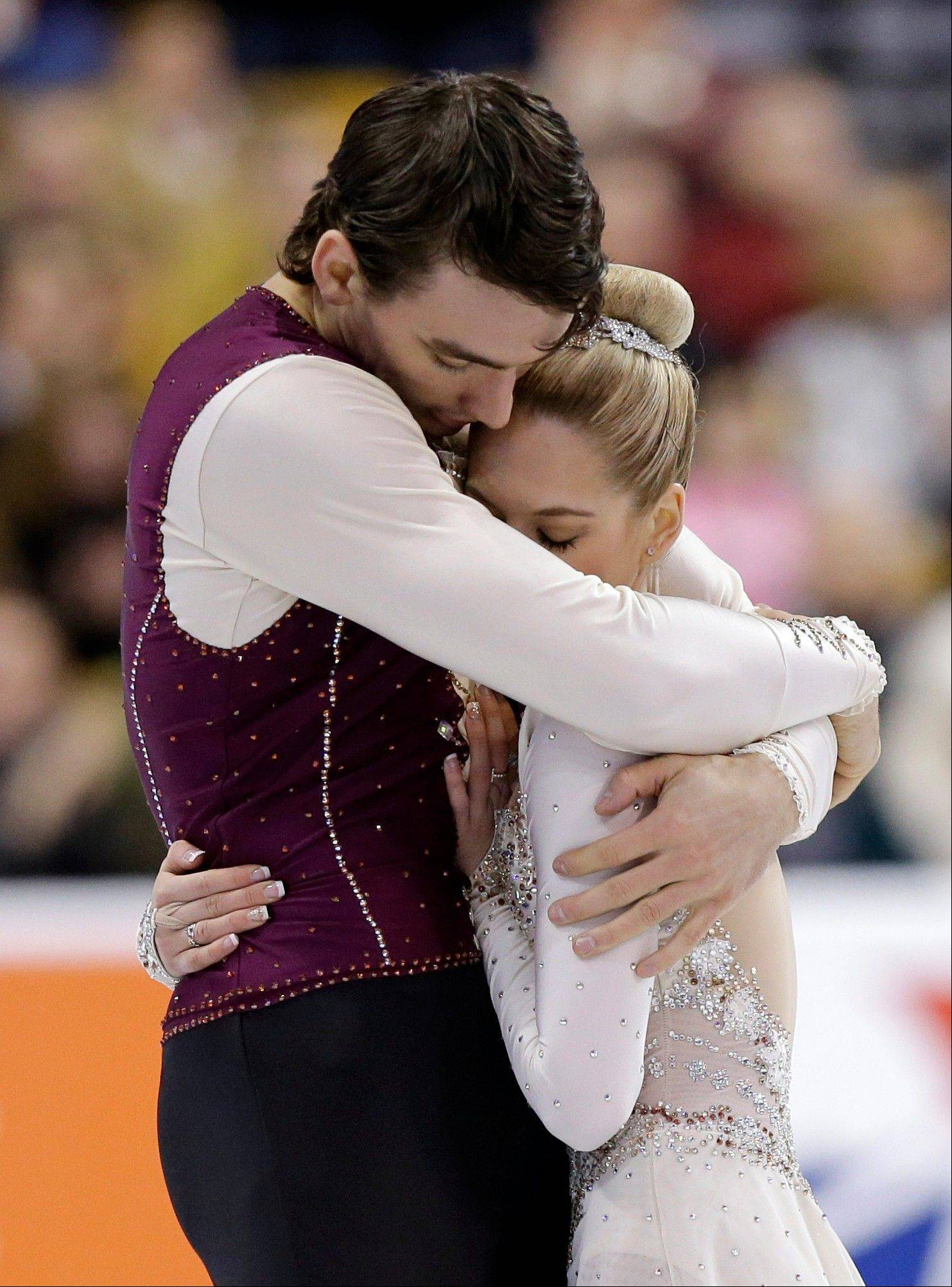 Alexa Scimeca of Addison and Christopher Knierim hug after skating during the pairs free skate at the U.S. Figure Skating Championships Saturday.