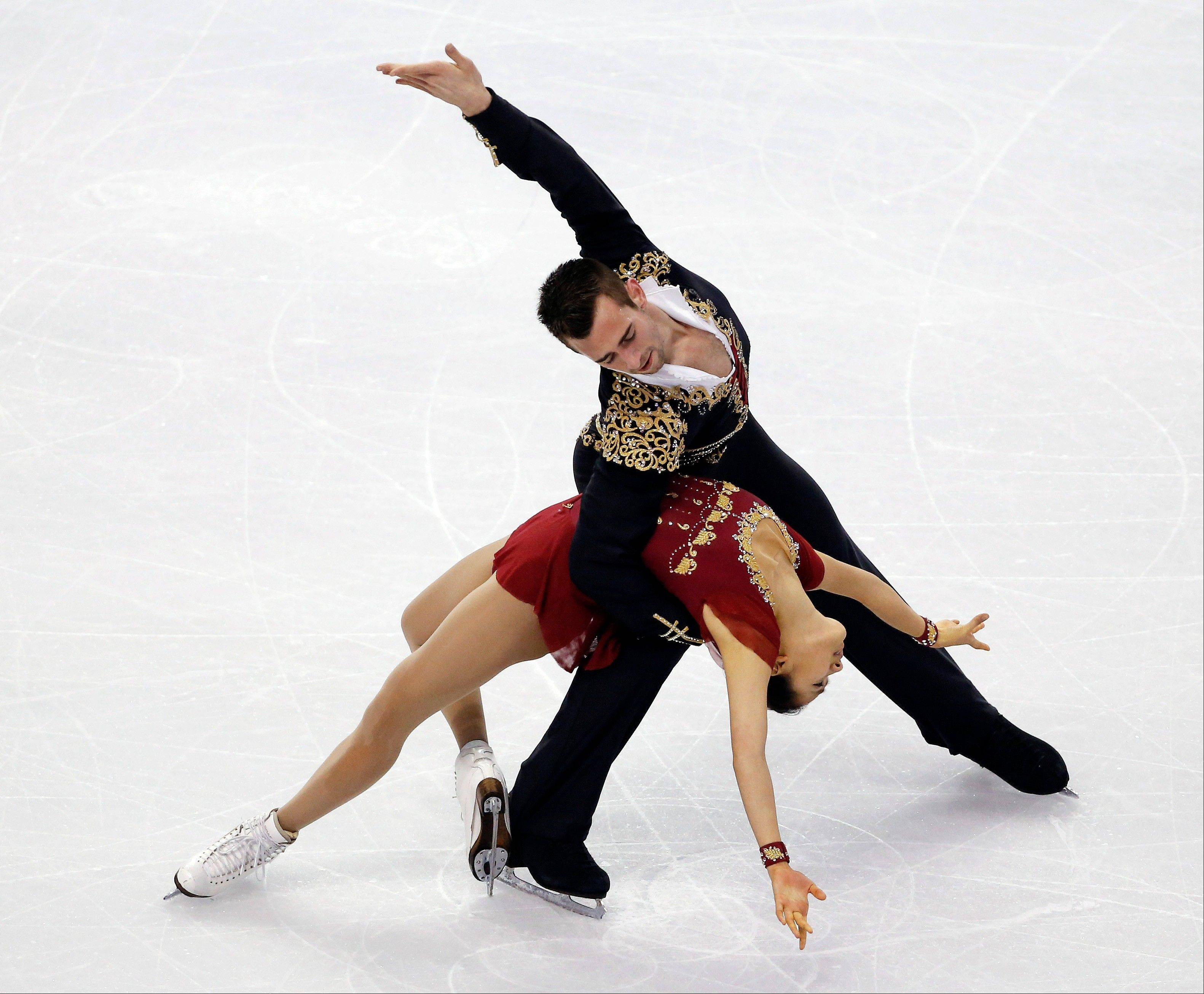 DeeDee Leng of Naperville and Timothy LeDuc show their form during the pairs free skate at the U.S. Figure Skating Championships in Boston.