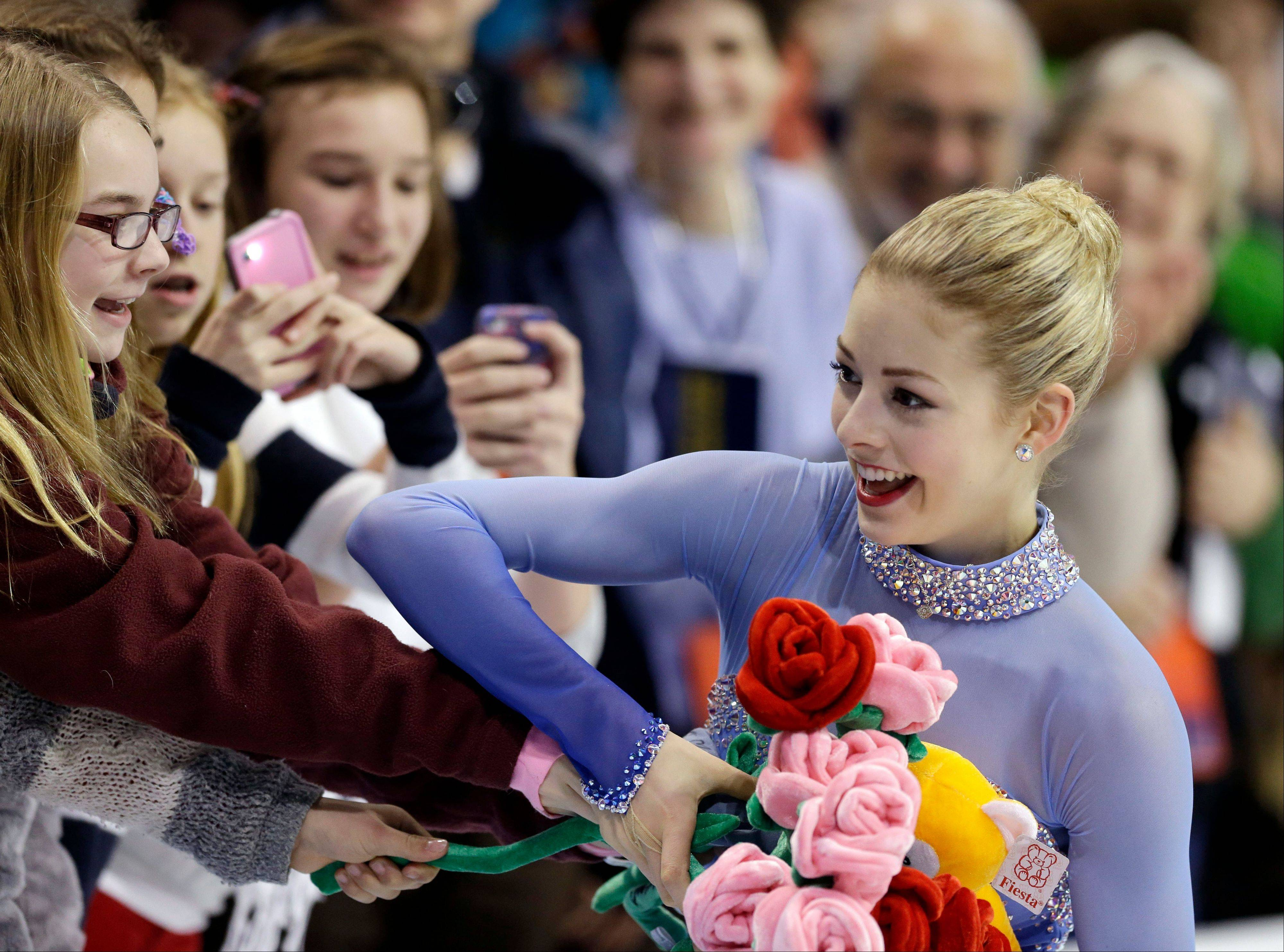 Gracie Gold receives flowers from fans after skating in the women's free skate at the U.S. Figure Skating Championships Saturday.