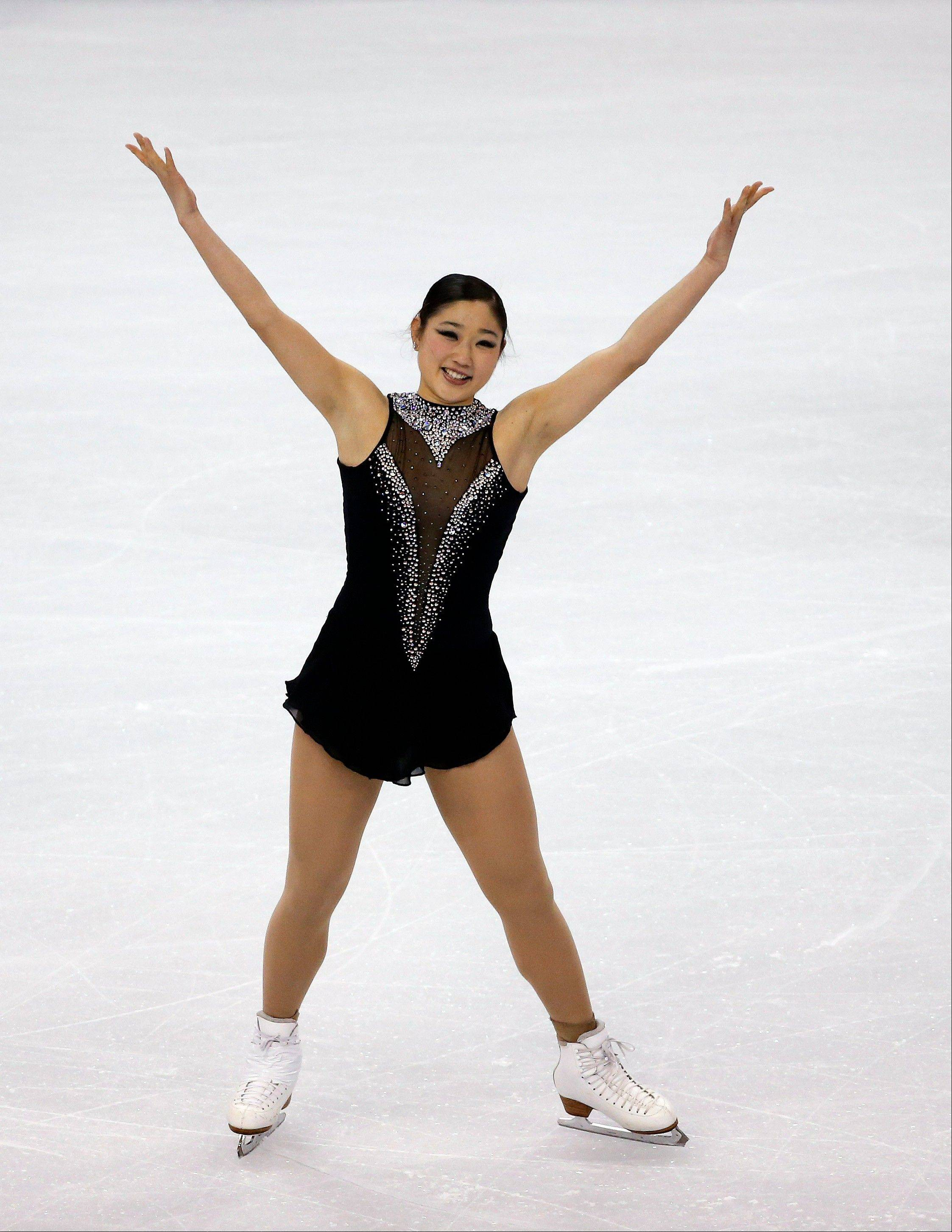 Mirai Nagasu reacts after giving a strong performance during the women's free skate at the U.S. Figure Skating Championships in Boston.