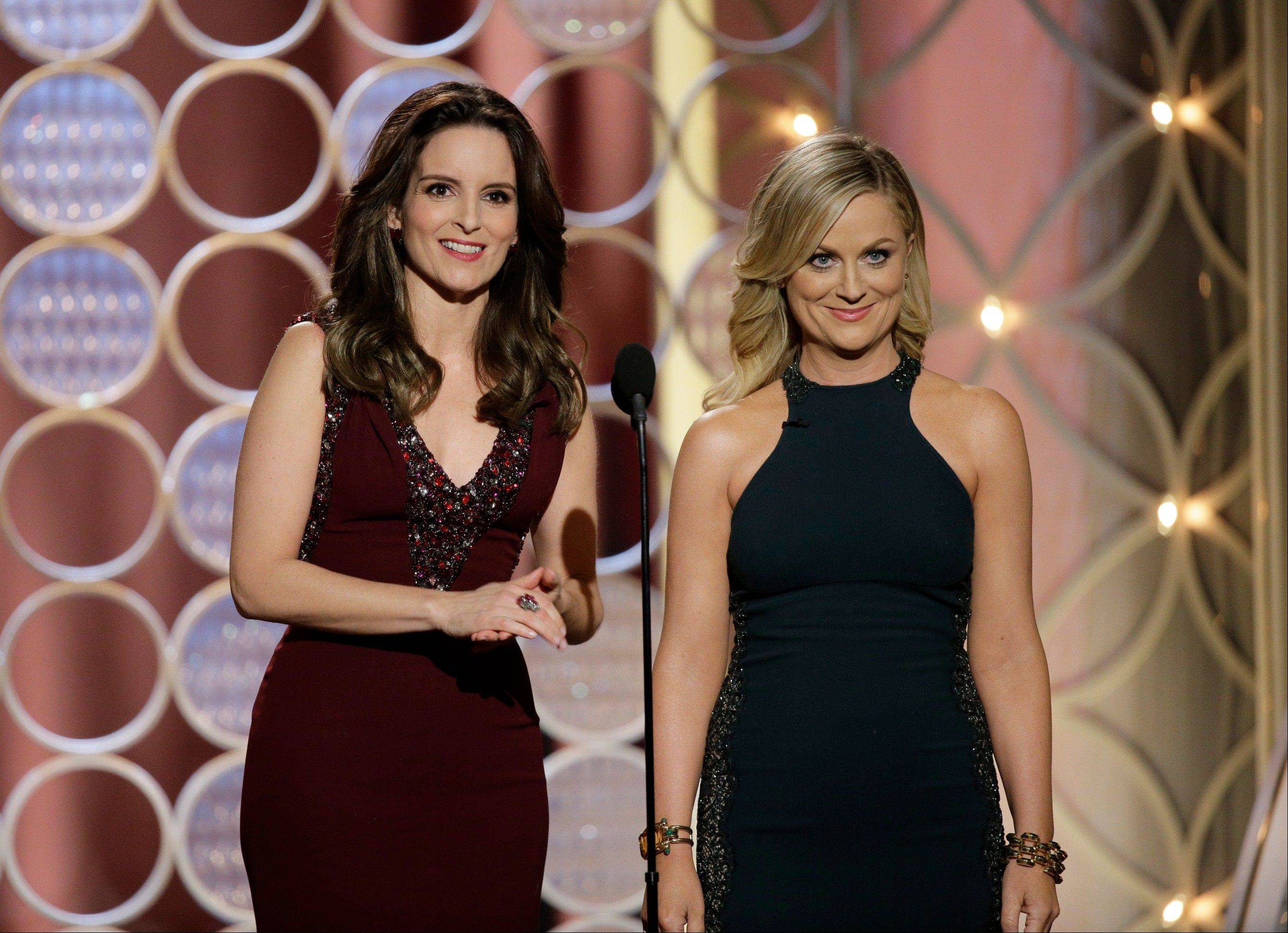 Tina Fey, left, and Amy Poehler brought the funny to the 71st annual Golden Globe Awards as they again shared hosting duties.