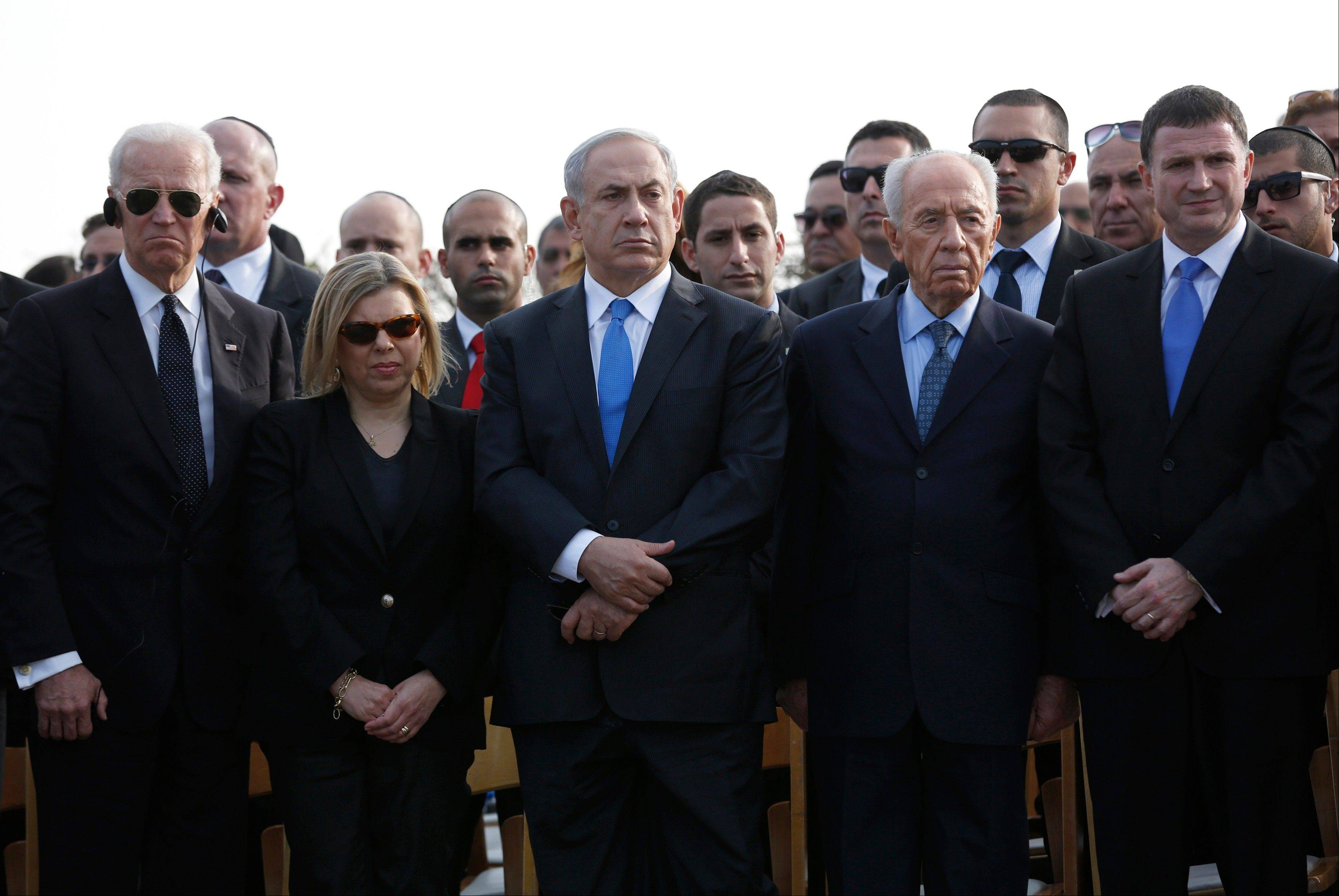 From right to left: Yuli Edelstein, speaker of Israel�s parliament; Israel�s President Shimon Peres; Prime Minister Benjamin Netanyahu and his wife, Sara; and U.S. Vice President Joe Biden attend the funeral of former Israeli Prime Minister Ariel Sharon in southern Israel Monday.