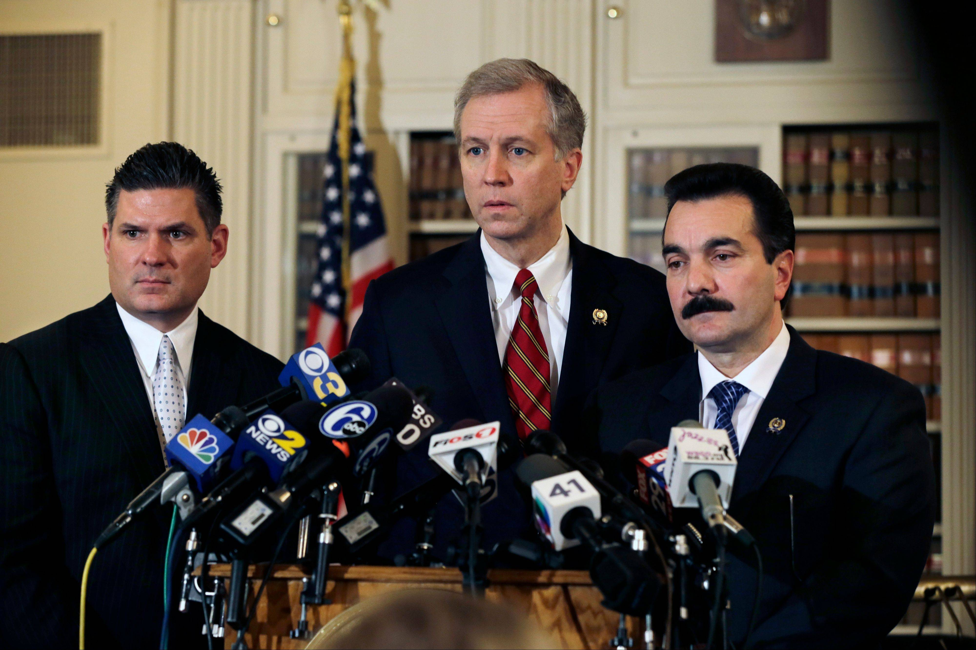 New Jersey Assemblymen John S. Wisniewski, center, Lou D. Greenwald, left, and incoming Assembly Speaker Vincent Prieto, all Democrats, address the media Monday in Trenton, N.J. Greenwald said an investigation into massive local traffic jams that has ensnared Gov. Chris Christie�s administration has grown into an abuse of power probe.