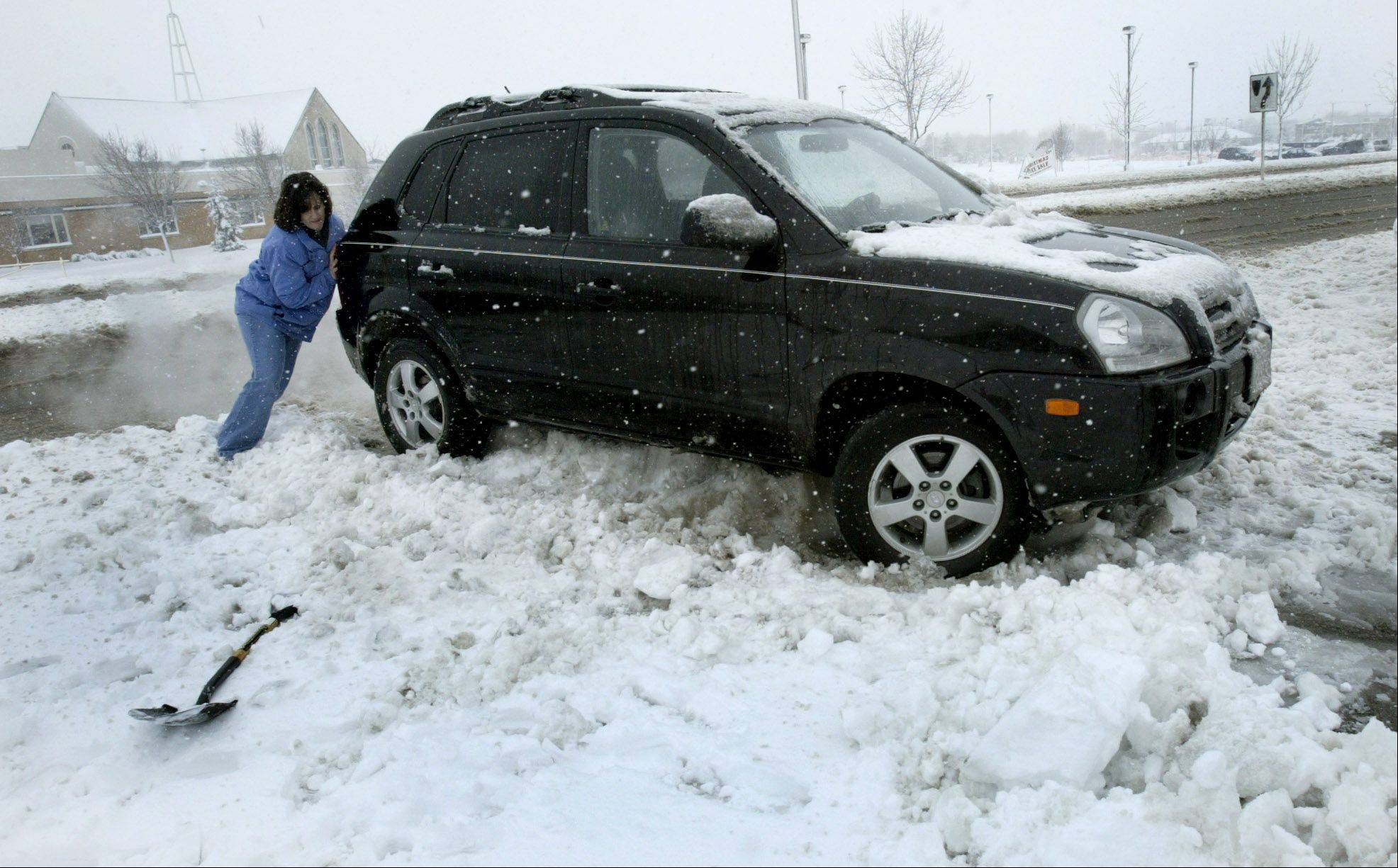Across the suburbs last week, cars got stuck in snow and fishtailed on icy streets.