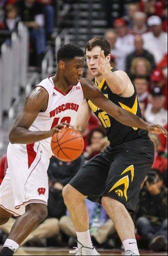 Wisconsin freshman Nigel Hayes, left, drives against Iowa�s Zach McCabe during the first half of the Jan. 5 game in Madison, Wis.
