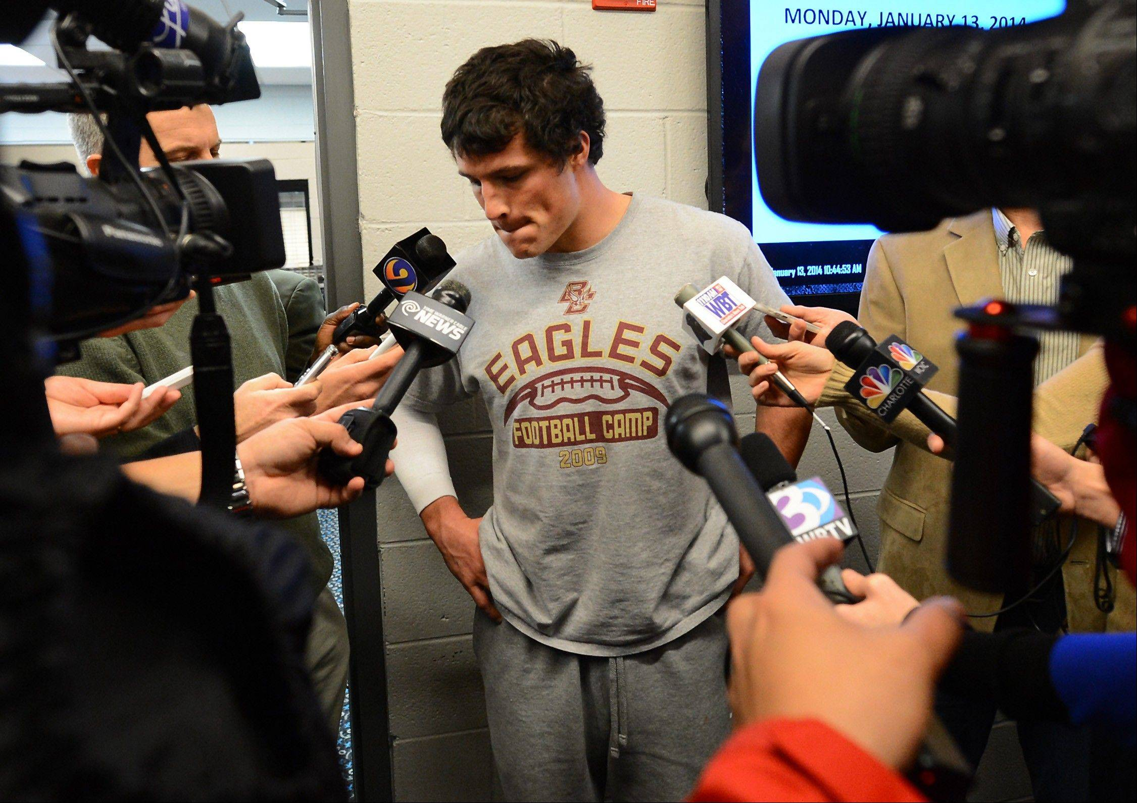 Carolina Panthers linebacker Luke Kuechly talks with reporters as he and his teammates clean out their lockers on Monday at Bank of America Stadium in Charlotte, N.C.