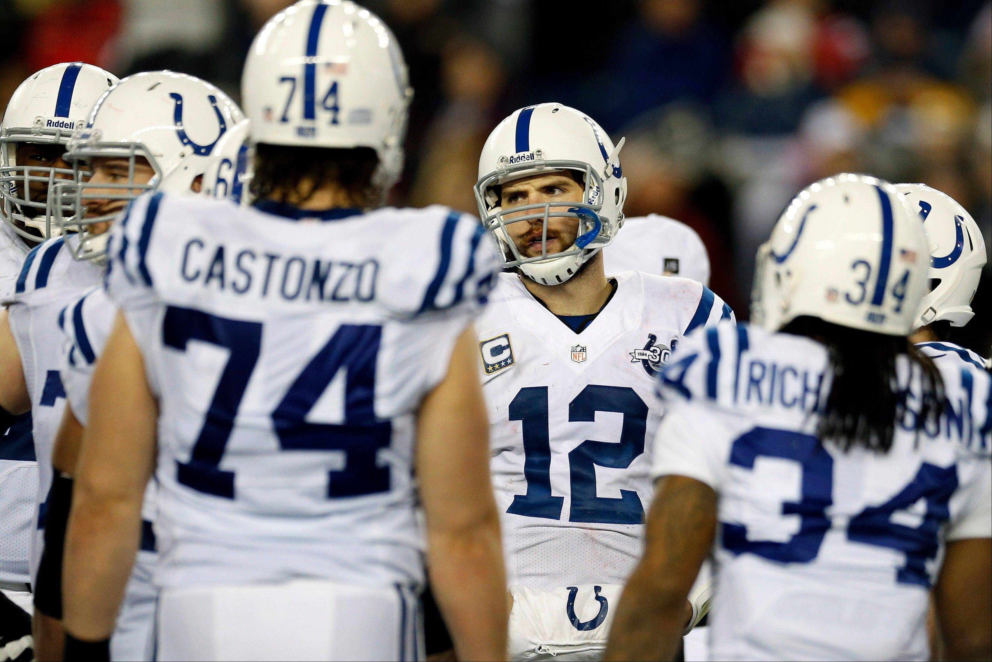 Indianapolis Colts quarterback Andrew Luck (12) stands with his team during the closing minutes of Saturday�s playoff loss to the New England Patriots in Foxborough, Mass.
