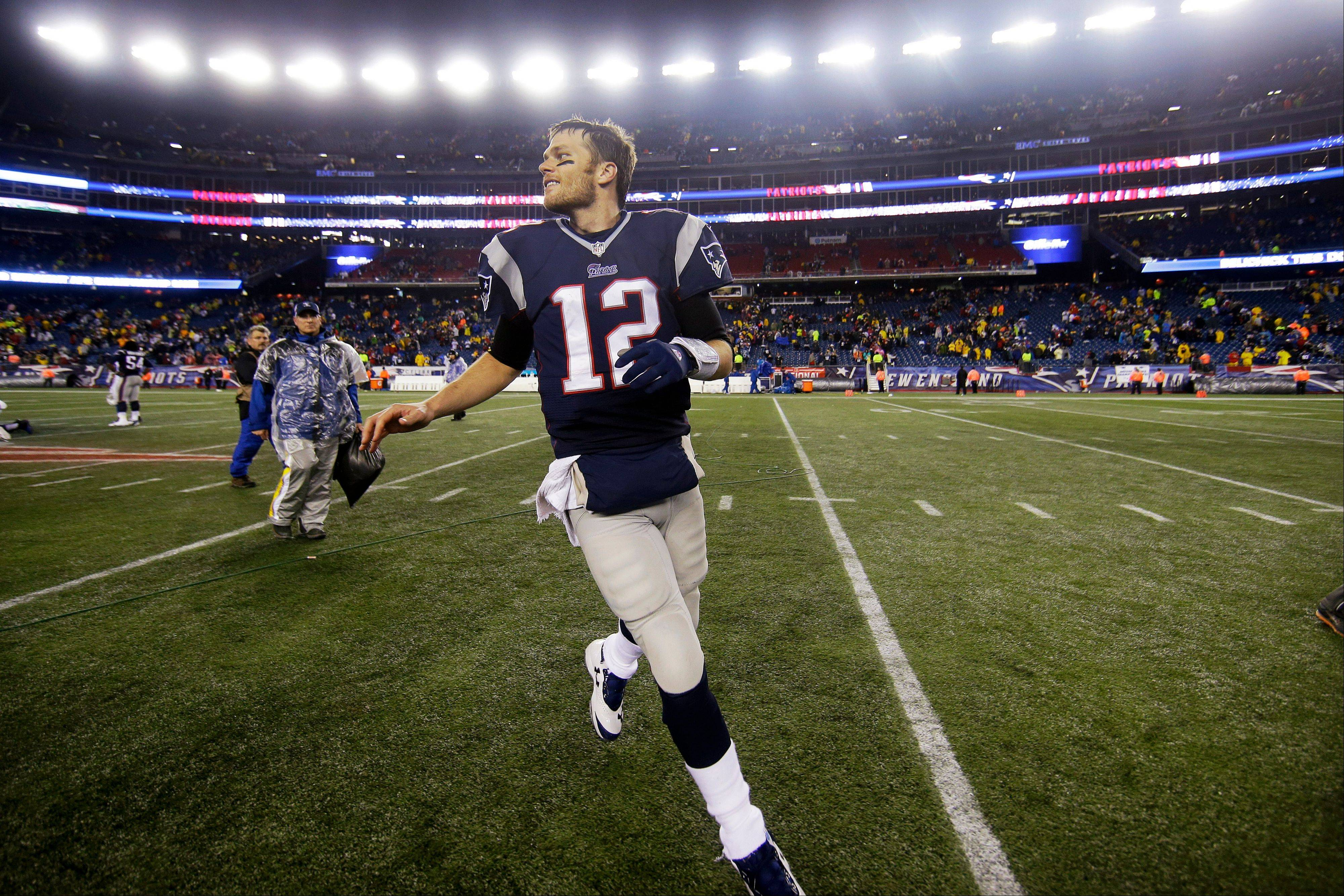Quarterback Tom Brady runs off the field after the Patriots routed the Colts in Saturday�s playoff game in Foxborough, Mass.