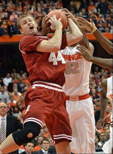 Indiana�s Luke Fischer grabs the ball from Syracuse�s Dajuan Coleman during the second half of the Dec. 3 game in Syracuse, N.Y.