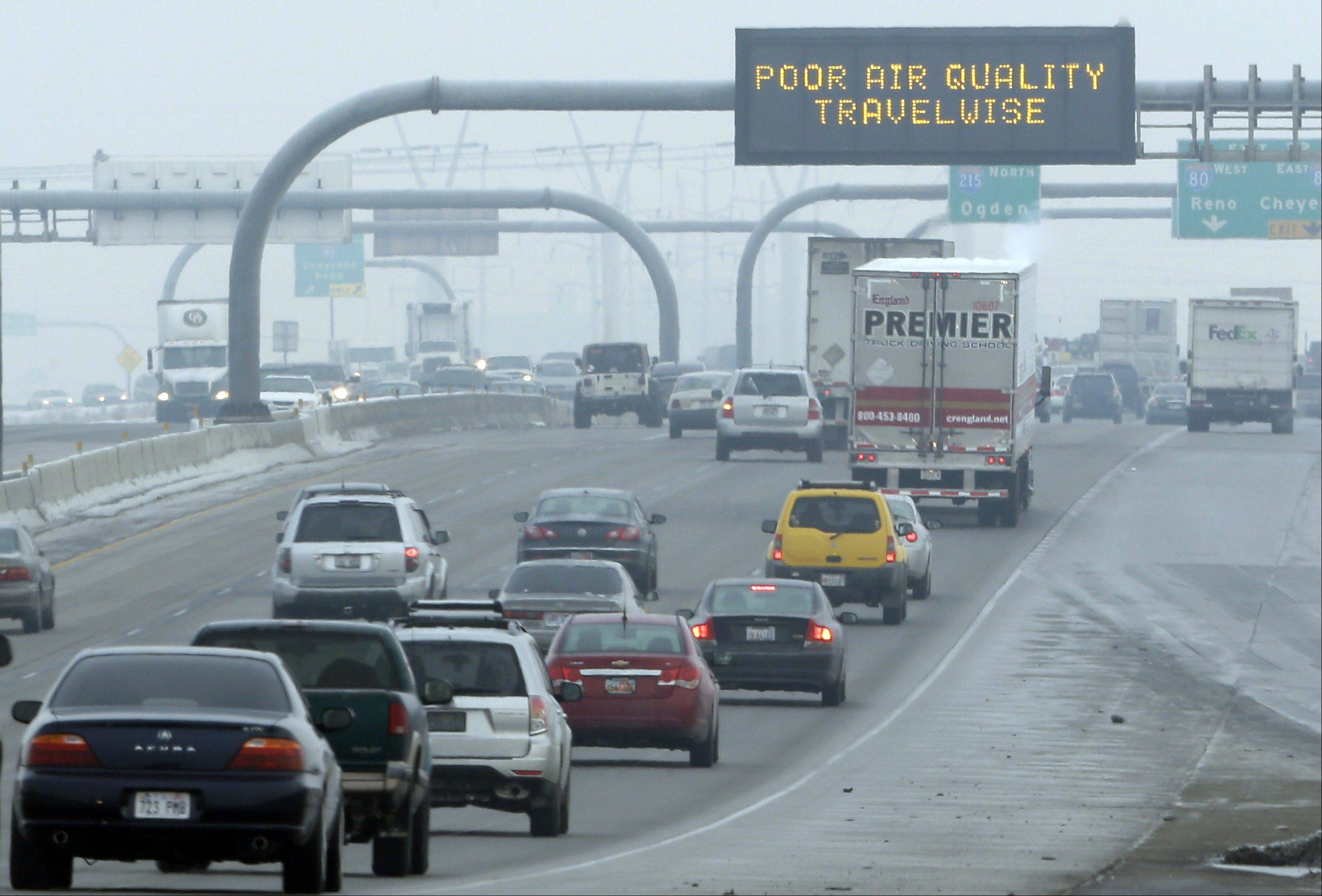 This Jan. 23, 2013, file photo shows a poor air quality sign is posted over a highway in Salt Lake City. A new government report released Jan. 13, 2014, says energy-related carbon dioxide pollution increased slightly in 2013 after declining for several years in a row.