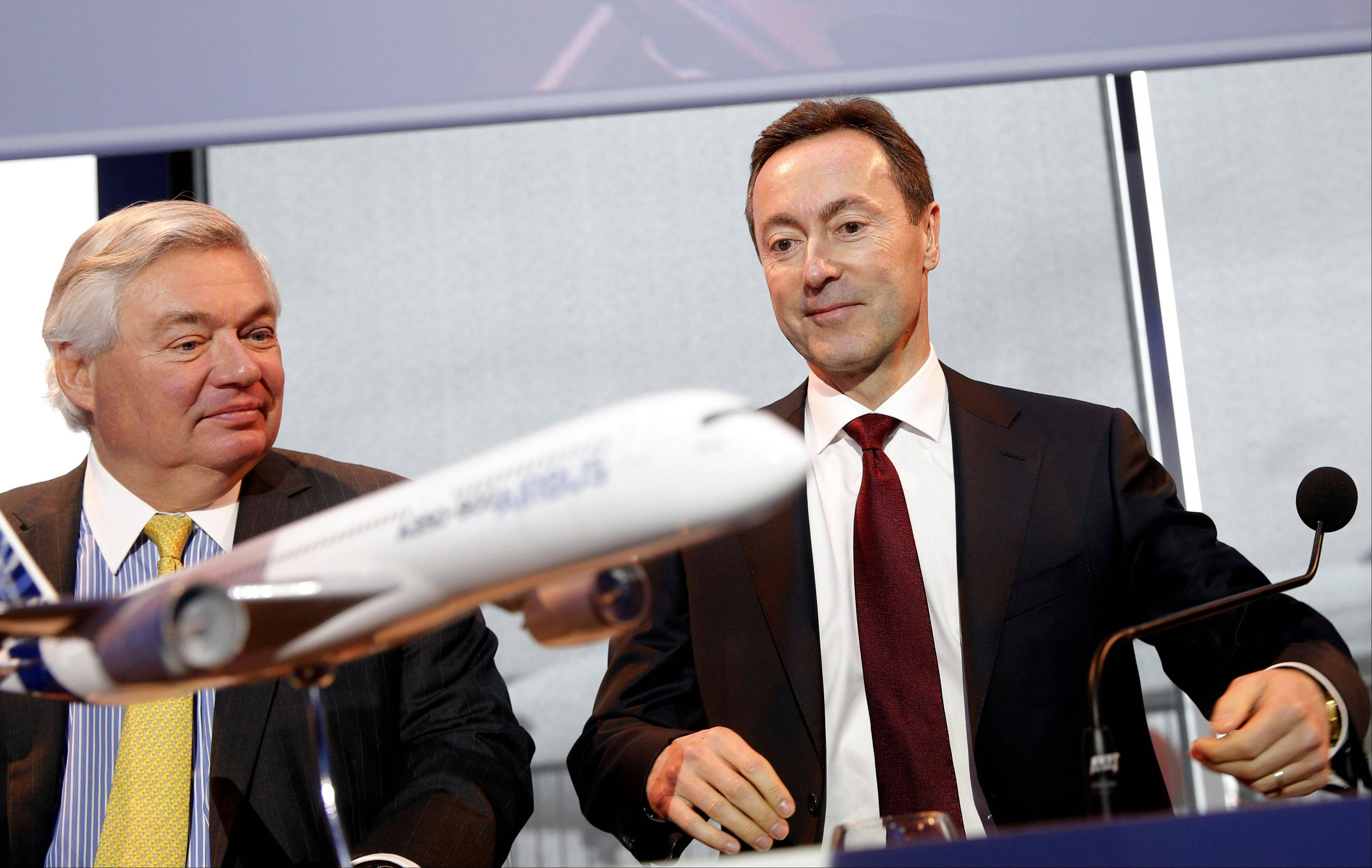 John Leahy, Chief Operating Officer Customers of Airbus, left, and Airbus CEO Fabrice Bregier, arrive for the annual news conference in Toulouse, southwestern France, Monday.